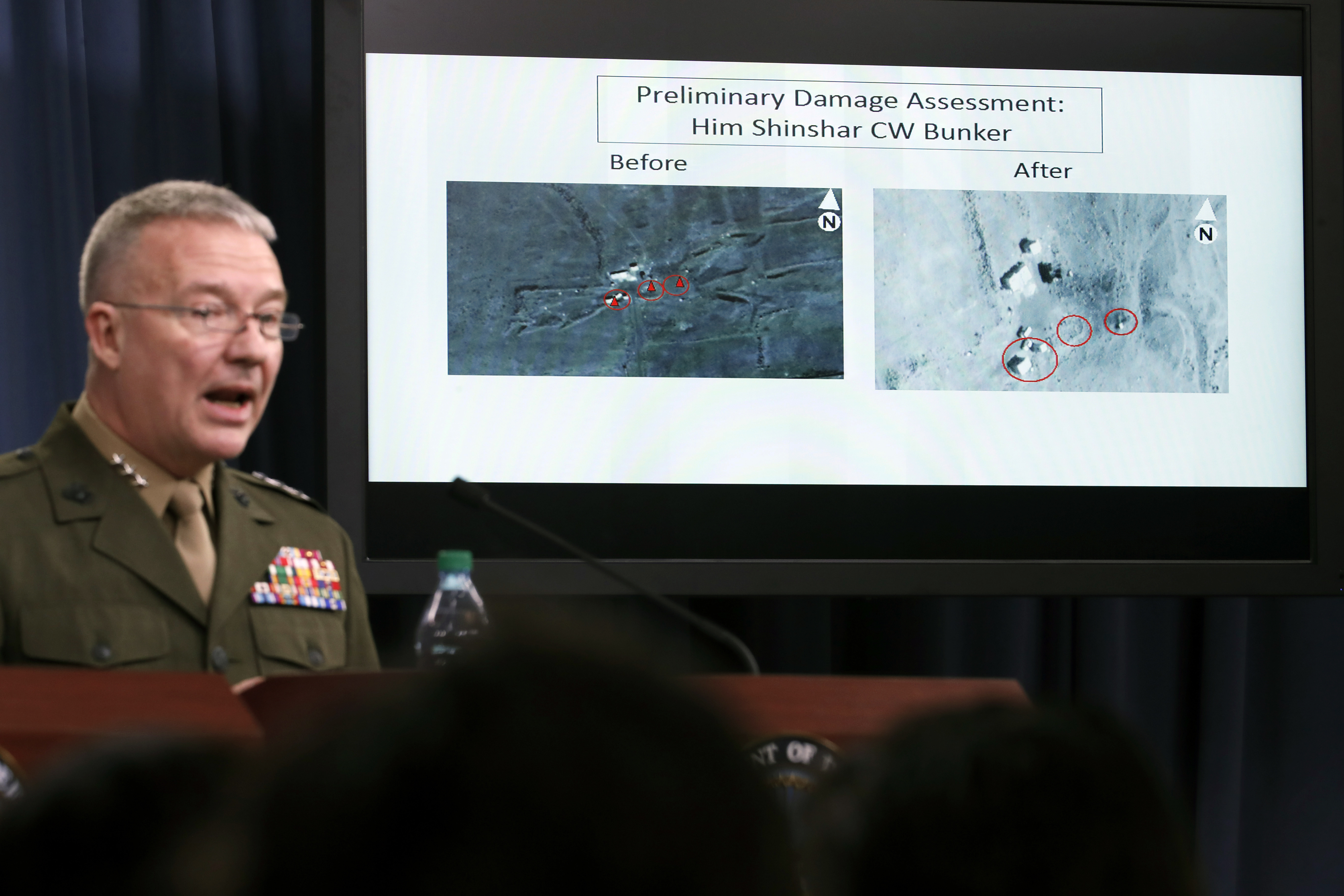 Marine Lt. Gen. Kenneth F. McKenzie Jr., director, Joint Staff, speaks as he shows photographs from before and after the U.S.-led airstrikes against Syria during a media availability at the Pentagon, April 14, 2018, in Washington.