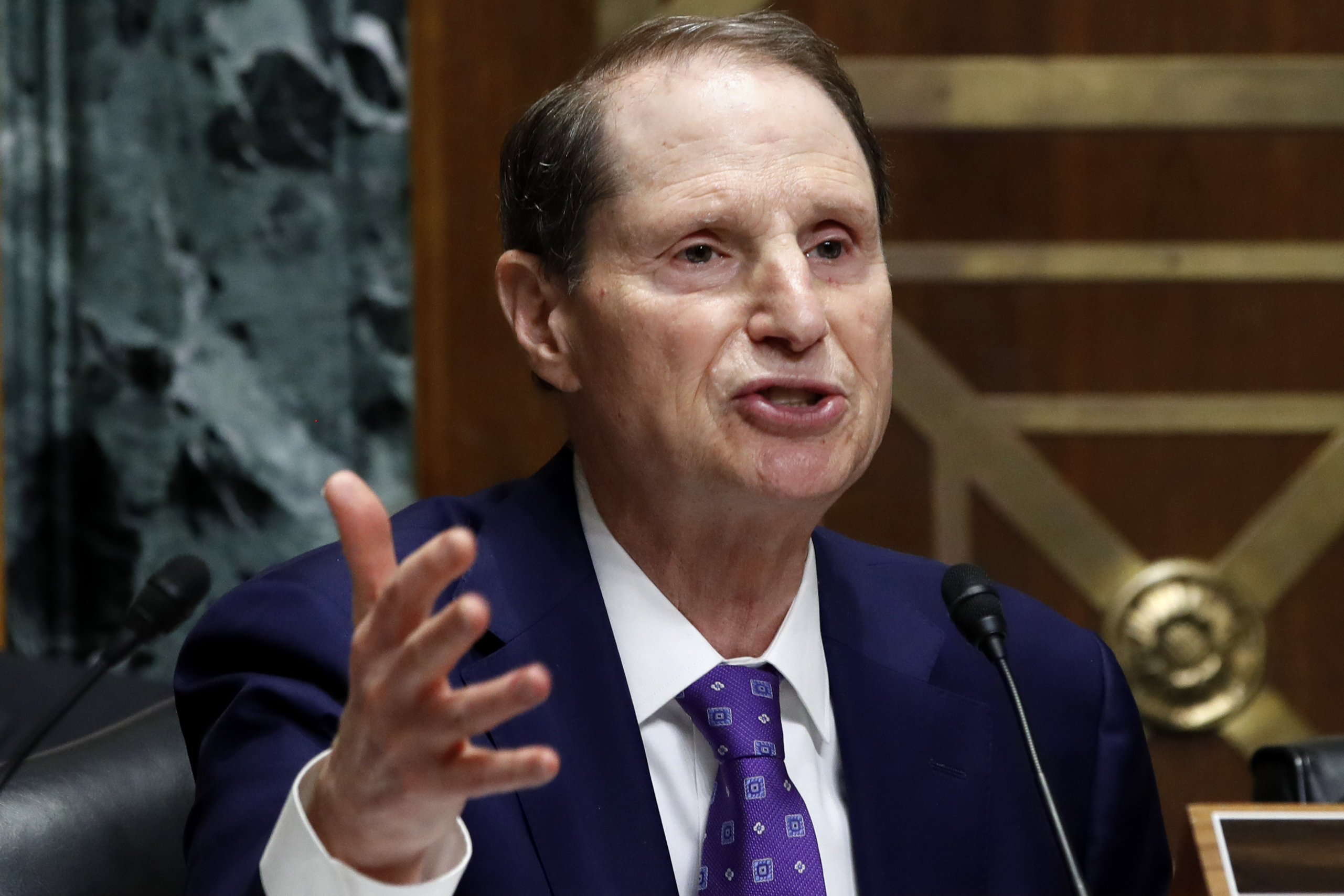 Ranking member of the Senate Finance Committee Sen. Ron Wyden, D-Ore., asks a question of Secretary of Commerce Wilbur Ross during a committee hearing on tariffs, on Capitol Hill, June 20, 2018, in Washington.