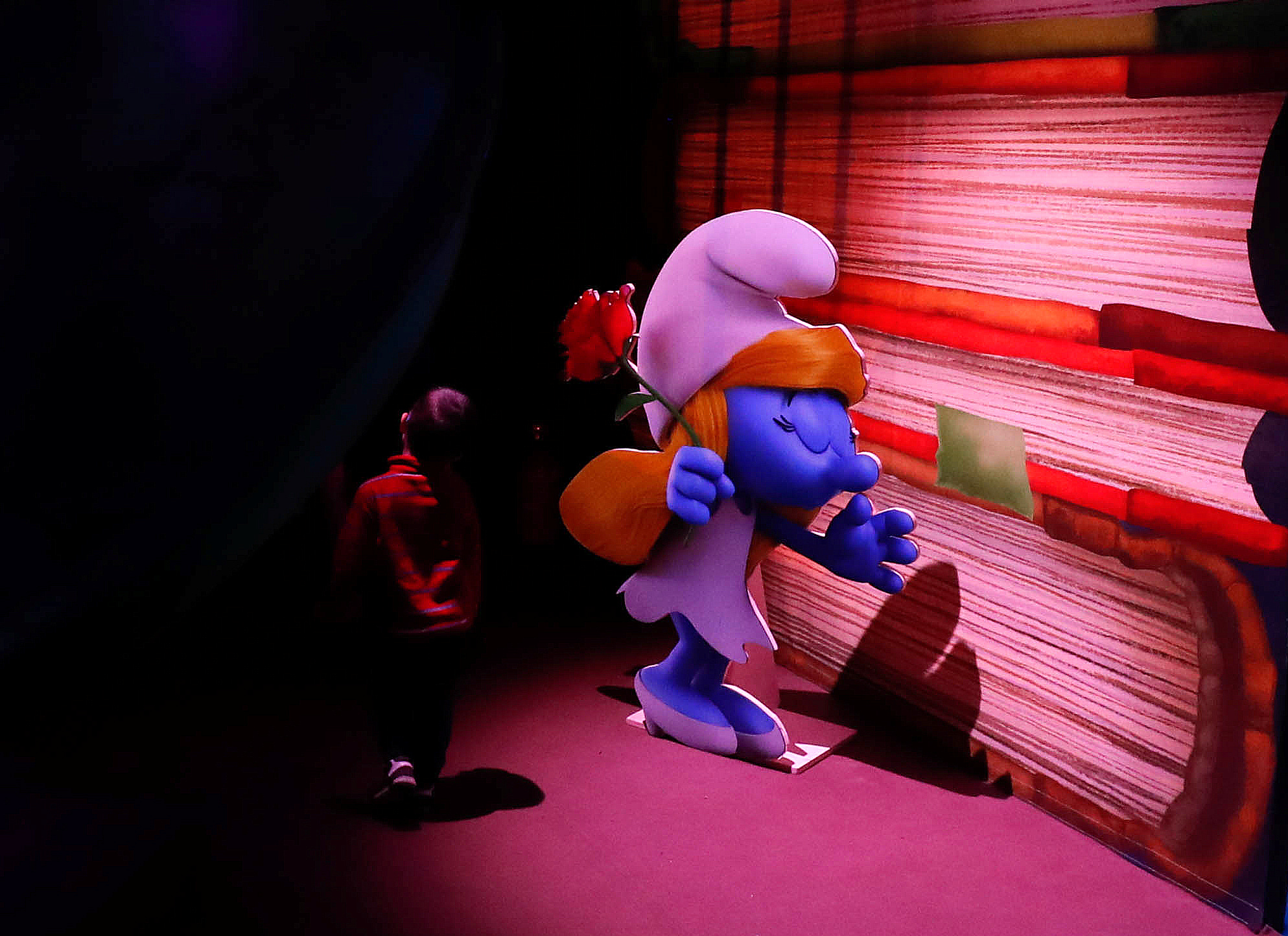 A boy walks past a Smurf character at the Smurf Experience exhibition, depicting a larger-than-life recreation of the Smurf village, marking the 60th anniversary of the creation of the Smurfs by cartoonist Peyo, in Brussels, Belgium, June 12, 2018.