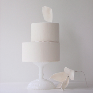 """Maggie Austin's ballet aesthetic is evident in her creations. """"A lot of times, with my cakes, there's always an element that goes up and off to the right a little bit, angling upwards,"""" she says."""