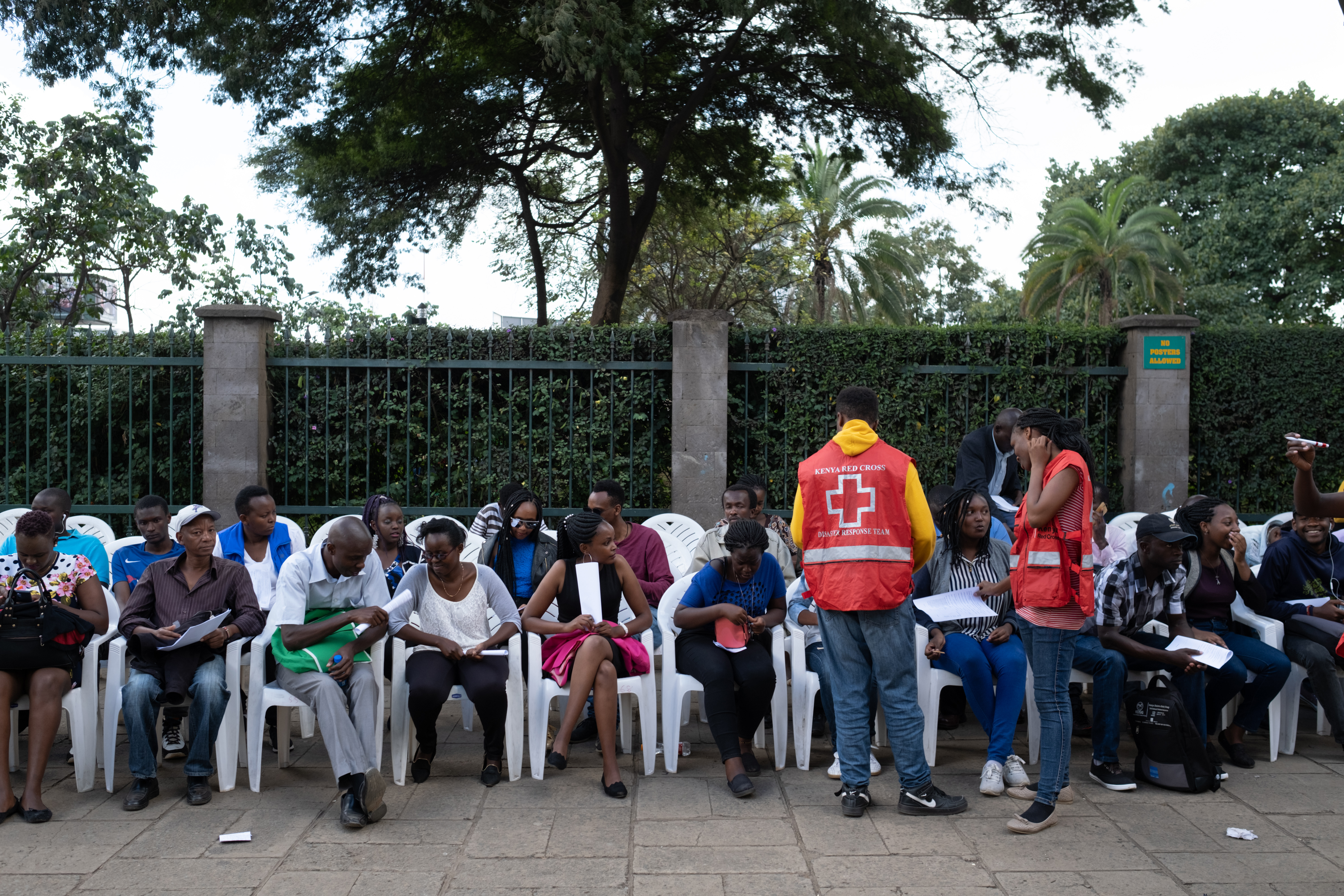 People wait for blood donation at the August 7th Memorial Park, where the 1998 terrorist bomb attack took place at the then United States Embassy, in Nairobi, Jan. 16, 2019, a day after a blast followed by a gun battle that rocked an upmarket hotel c...