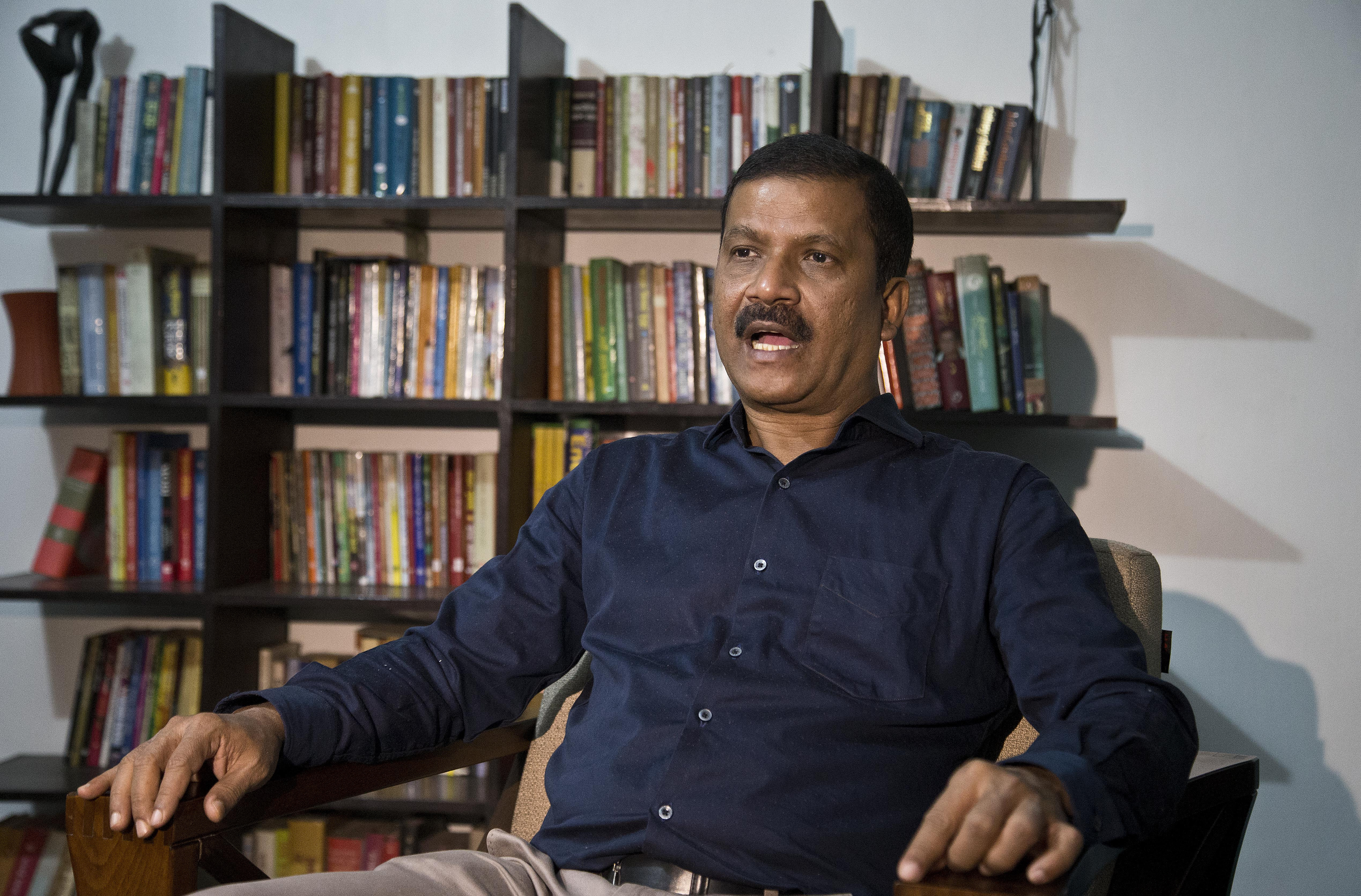 Asif Nazrul, a law professor at Dhaka University and a government critic, speaks to the Associated Press in Dhaka, Bangladesh, Jan. 1, 2019.