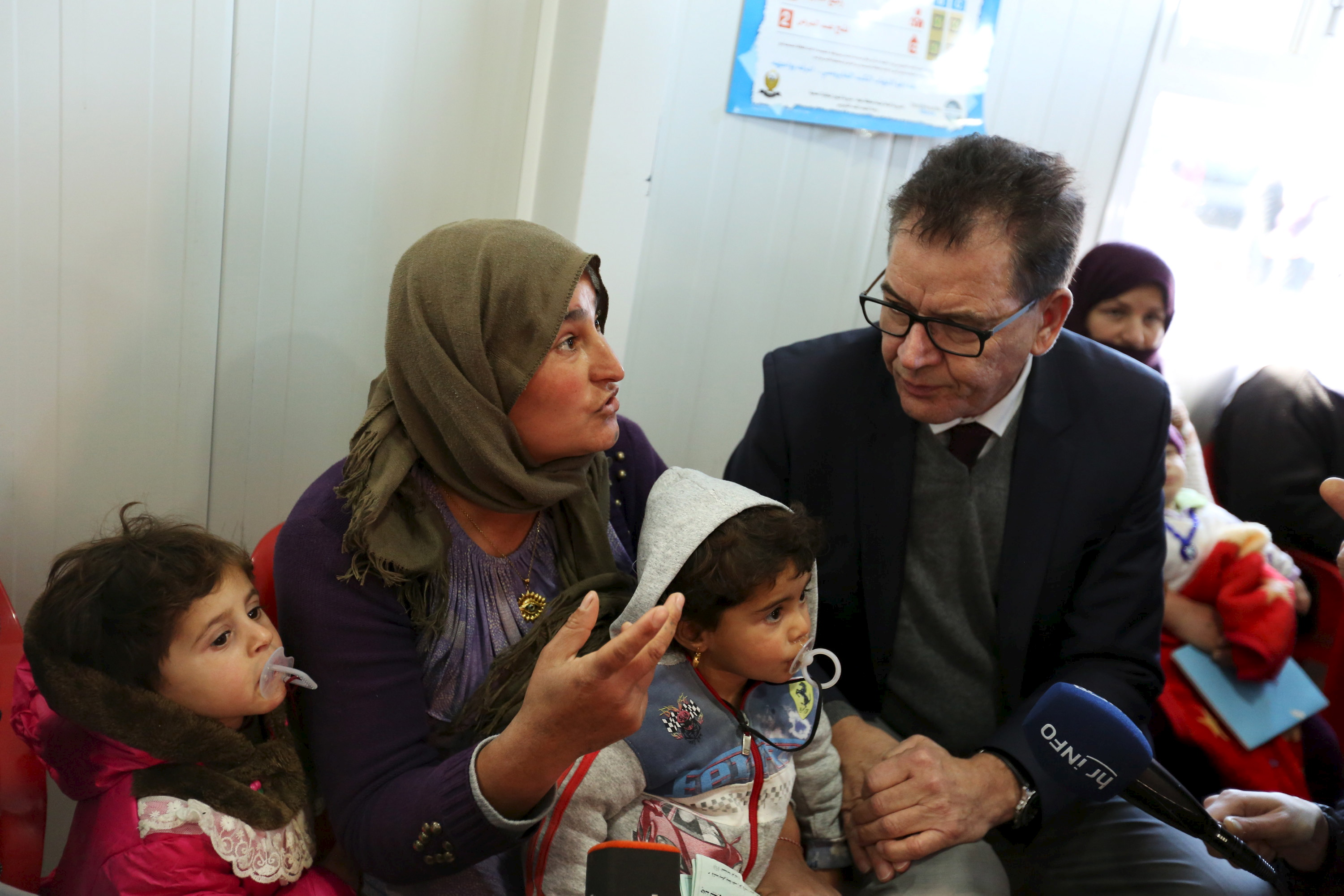 German Minister of Economic Cooperation and Development Gerd Mueller visits Syrian refugees, at the Domiz refugee camp in the northern Iraqi province of Dohuk, Jan. 28, 2016.