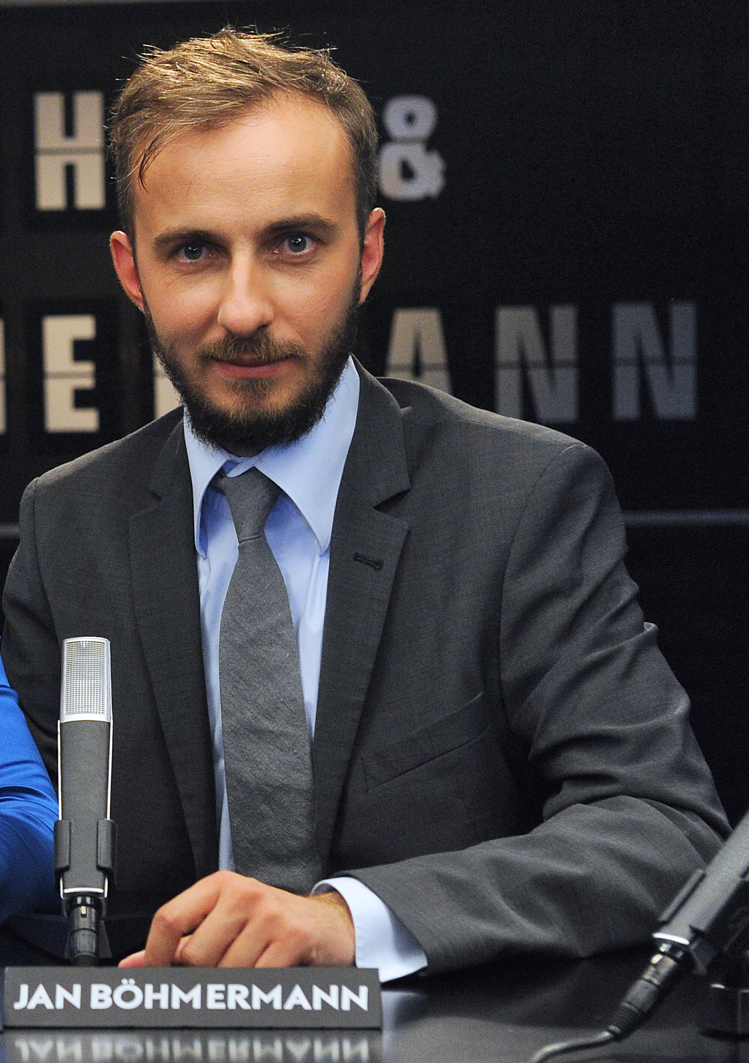 In this Aug. 28, 2012, photo, German comedian Jan Boehmermann is seen hosting a talk show in Cologne, western Germany. A recent poem by Bohmerman lampooning Erdogan has prompted the Turkish president to launch his latest free speech challenge.