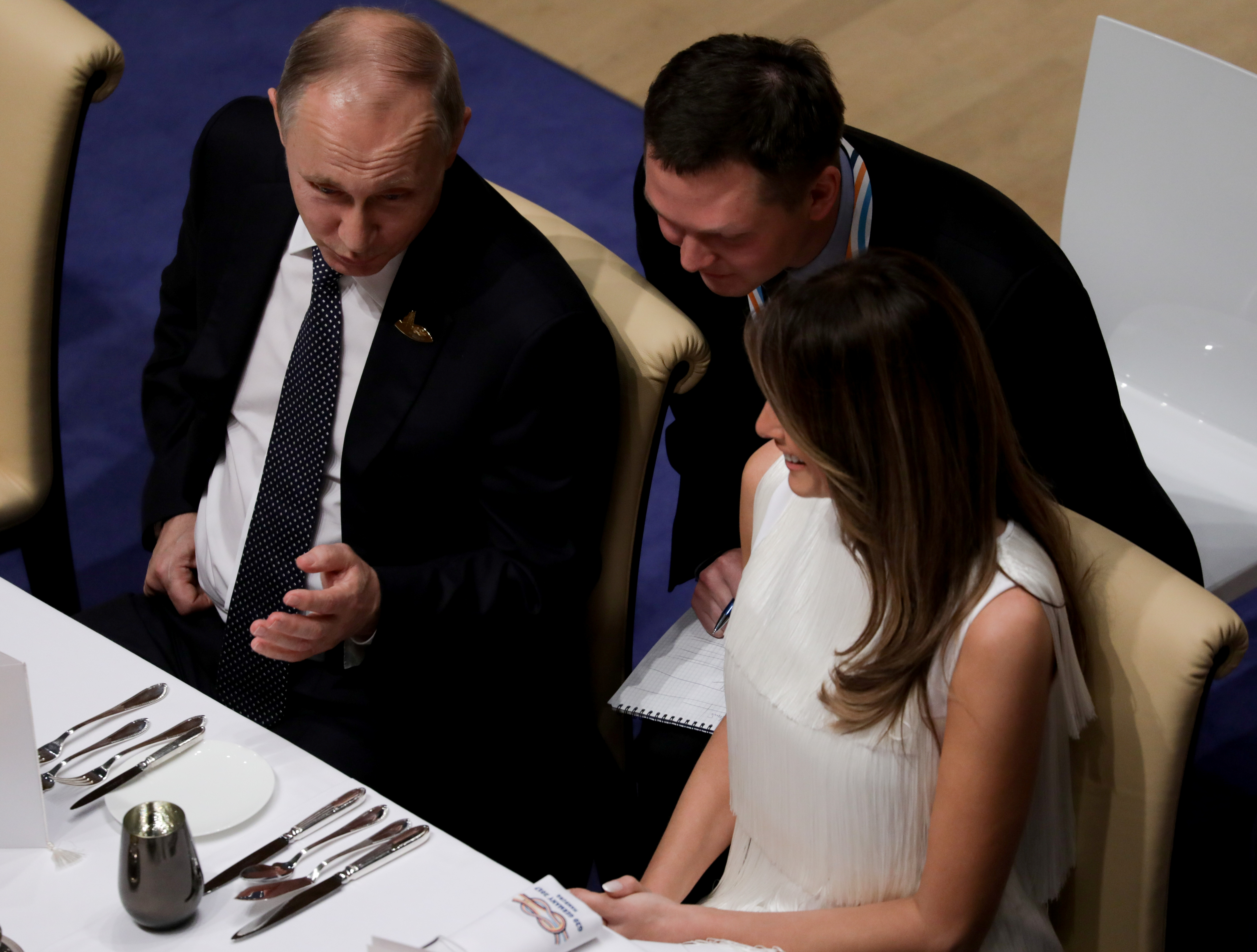 Russia's President Vladimir Putin talks to Melania Trump during the official dinner at the Elbphilharmonie Concert Hall during the G20 summit in Hamburg, Germany, July 7, 2017.