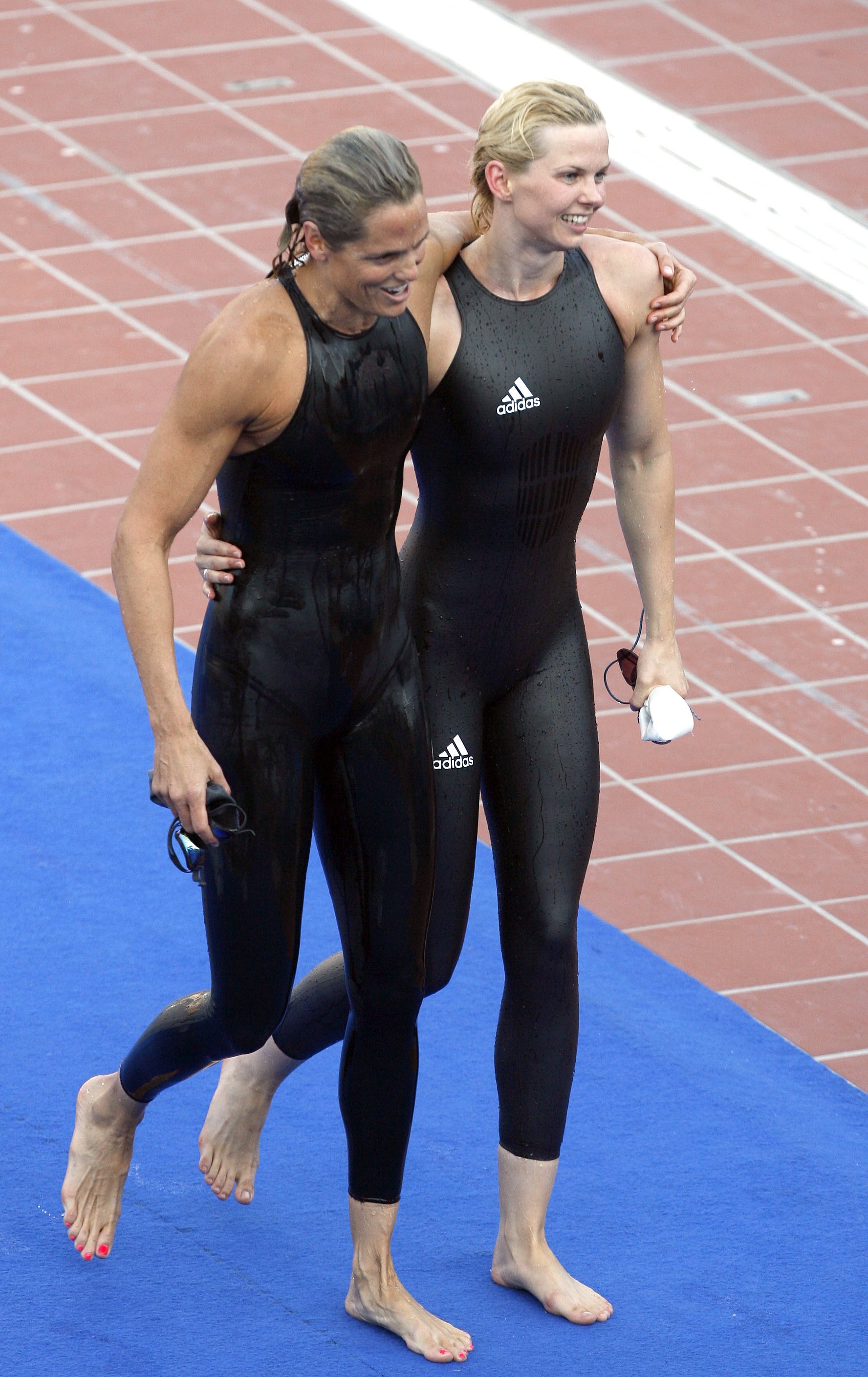 FILE - Germany's Britta Steffen, right, walks off with Dara Torres of the United States after winning a women's 50-meter freestyle final at the FINA Swimming World Championships in Rome, Aug. 2, 2009. Swimsuit design wars culminated with a ludicrous ...