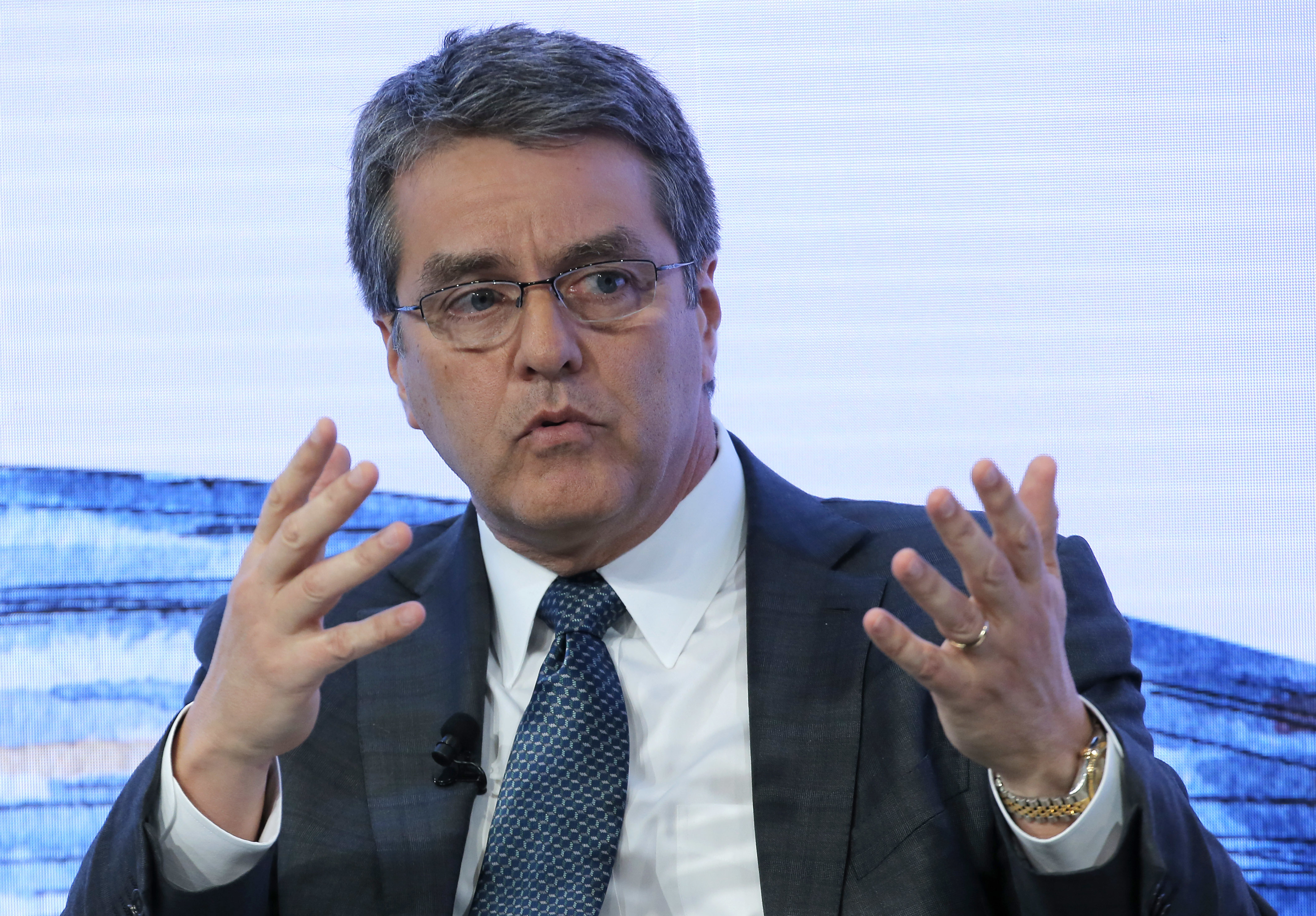 FILE - Roberto Azevedo director general of the World Trade Organization gestures as he speaks on the third day of the annual meeting of the World Economic Forum in Davos, Switzerland.