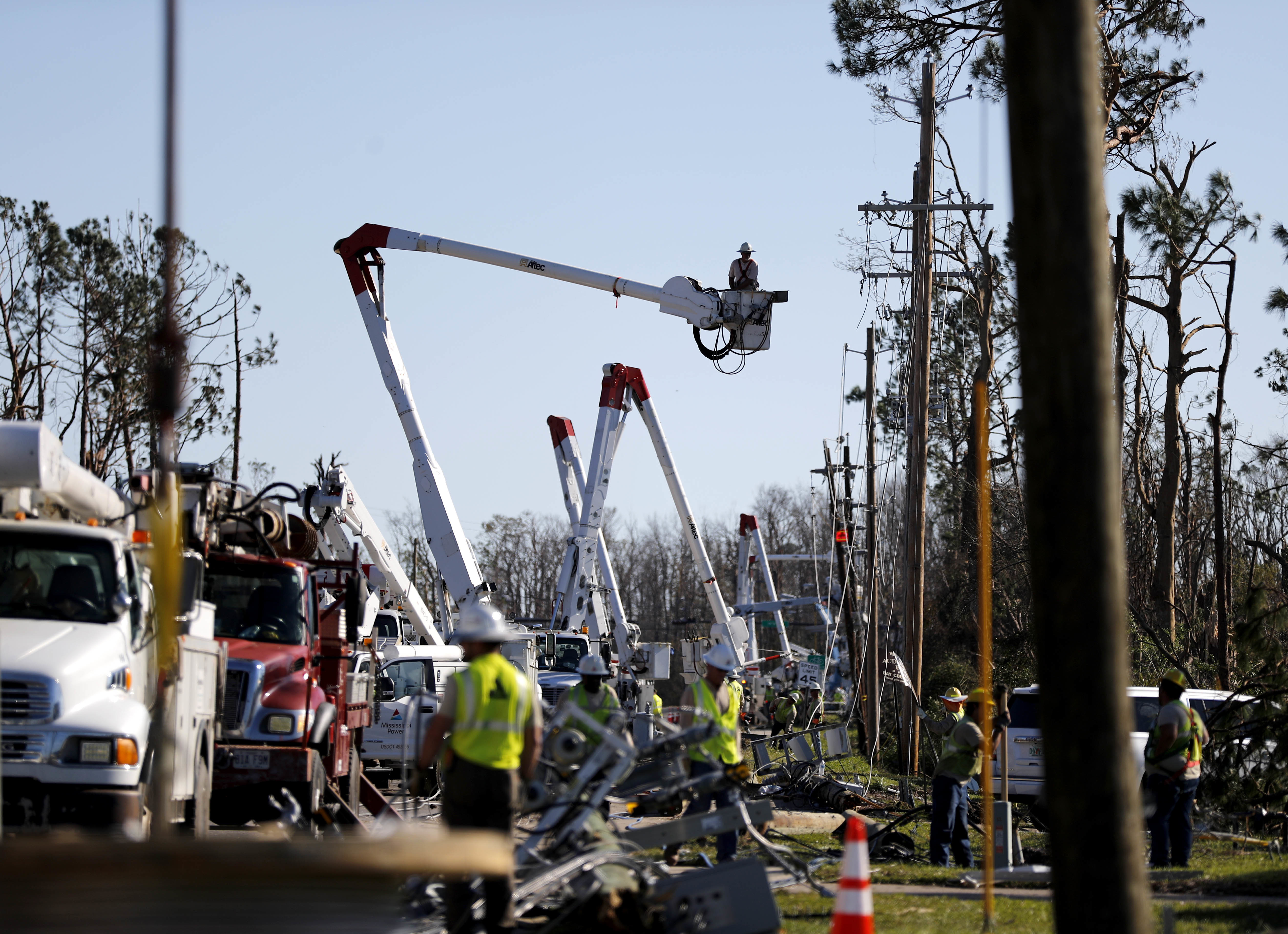 Crews work to restore power in the aftermath of Hurricane Michael in Panama City, Fla., Oct. 13, 2018.