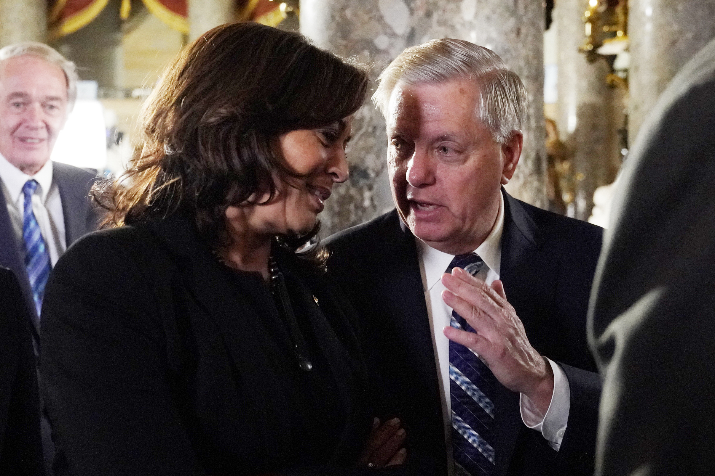 Sen. Kamala Harris, D-Calif and Sen. Lindsey Graham, R-S.C. talk as they arrive to listen to President Donald Trump deliver his State of the Union address to a joint session of Congress on Capitol Hill in Washington, Tuesday, Feb. 5, 2019.