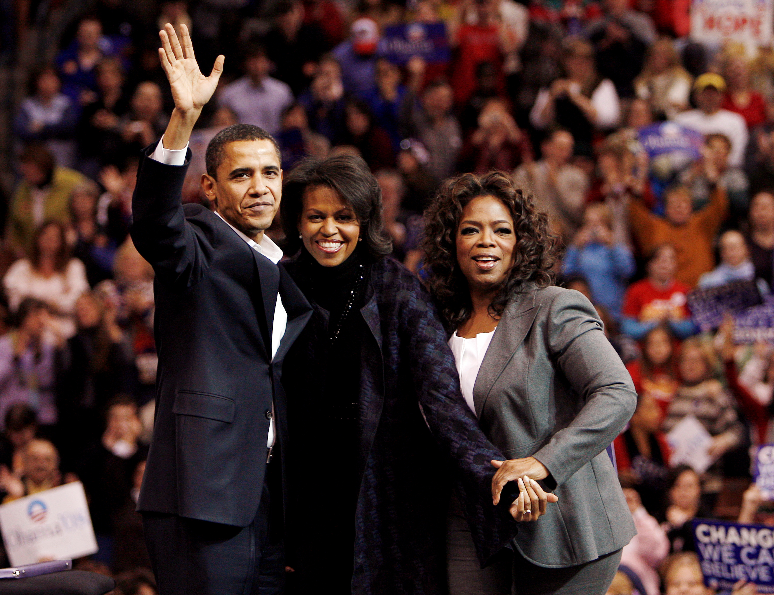 FILE - Democratic presidential candidate U.S. Senator Barack Obama, left, his wife Michelle, center, and talk show host Oprah Winfrey wave to the crowd at a campaign rally in Manchester, New Hampshire, Dec. 9, 2007.