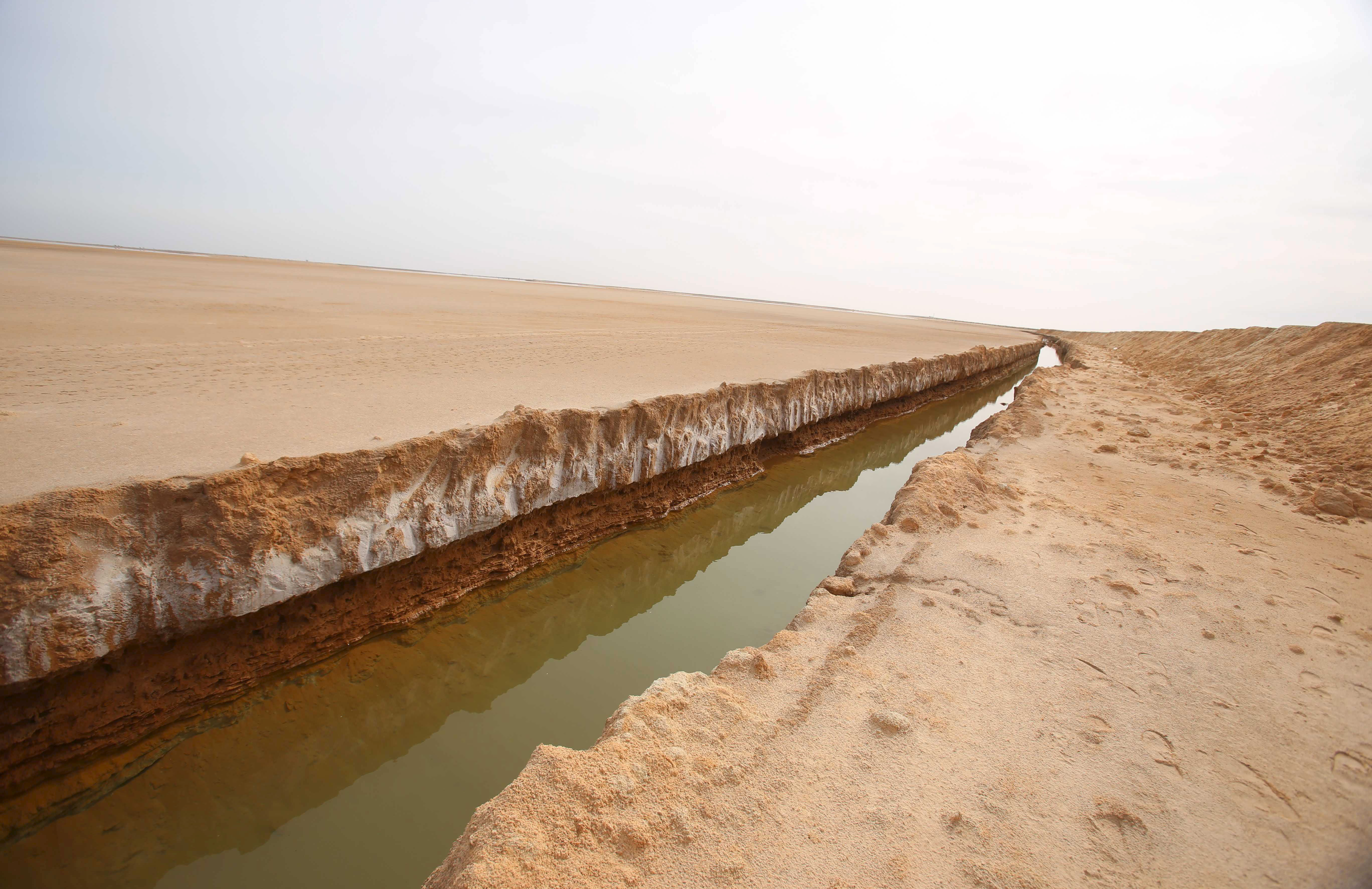 A general view of a trench, that forms part of a barrier along the frontier with Libya, is seen in Sabkeht Alyun, Tunisia February 6, 2016.