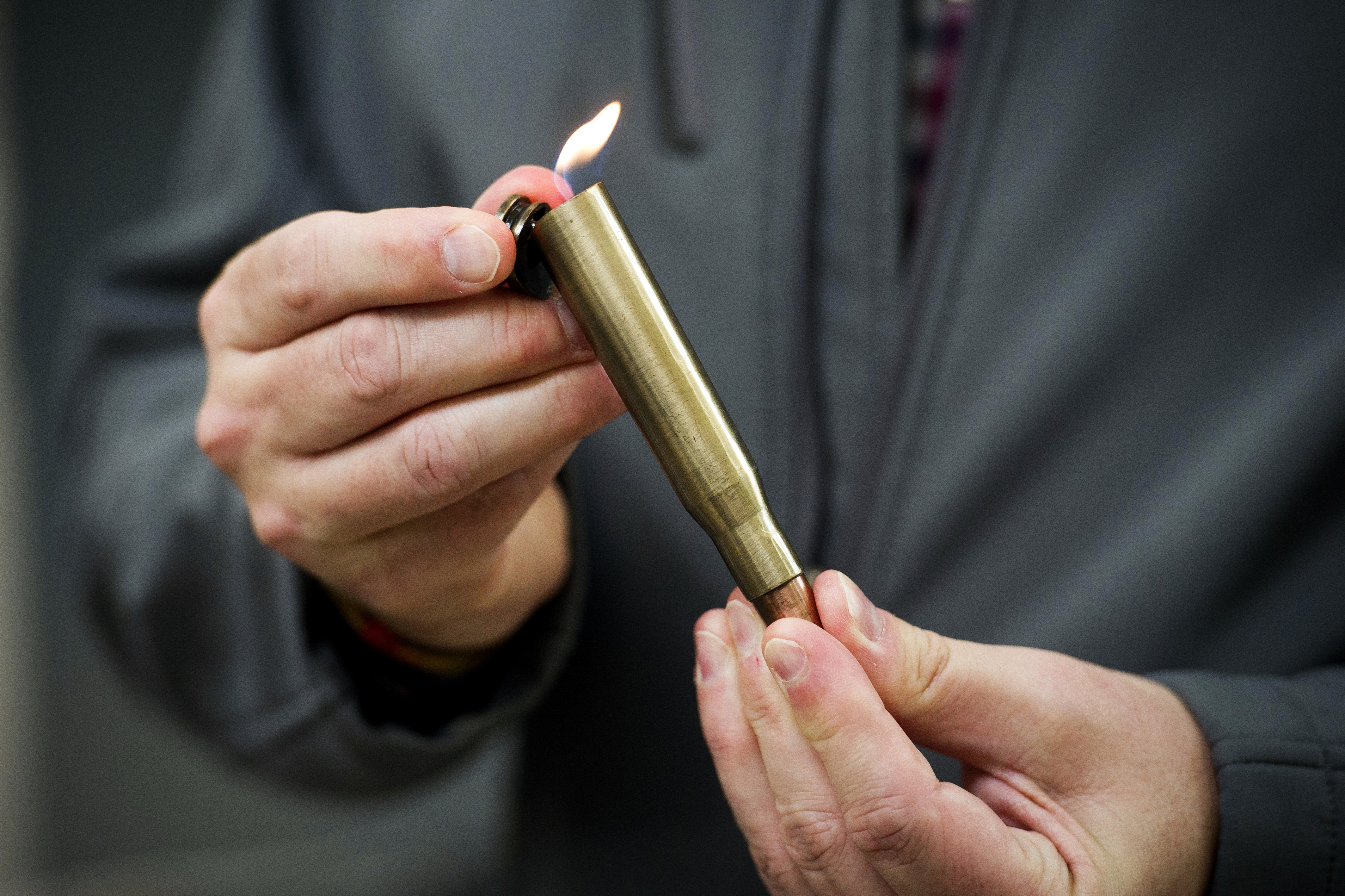 David Johnston, TSA's social media director, displays a lighter mounted inside of a bullet casing which was confiscated from a passenger at a Transportation Security Administration (TSA) checkpoint at Dulles International Airport in Dulles, Va., Marc...
