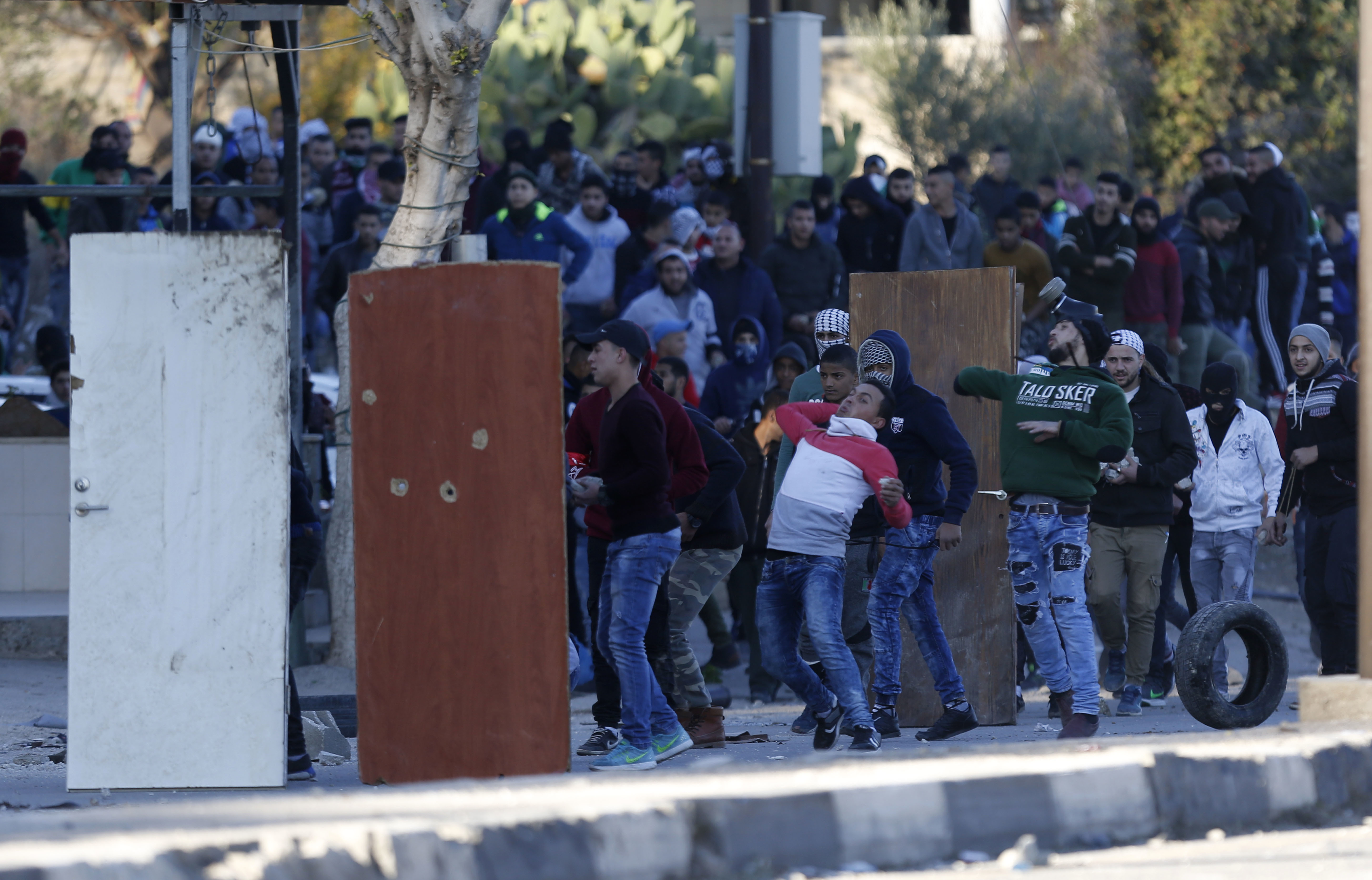 Palestinians clash with Israeli troops during a protest against U.S. President Donald Trump's decision to recognize Jerusalem as the capital of Israel in the West Bank City of Nablus, Dec. 8, 2017.
