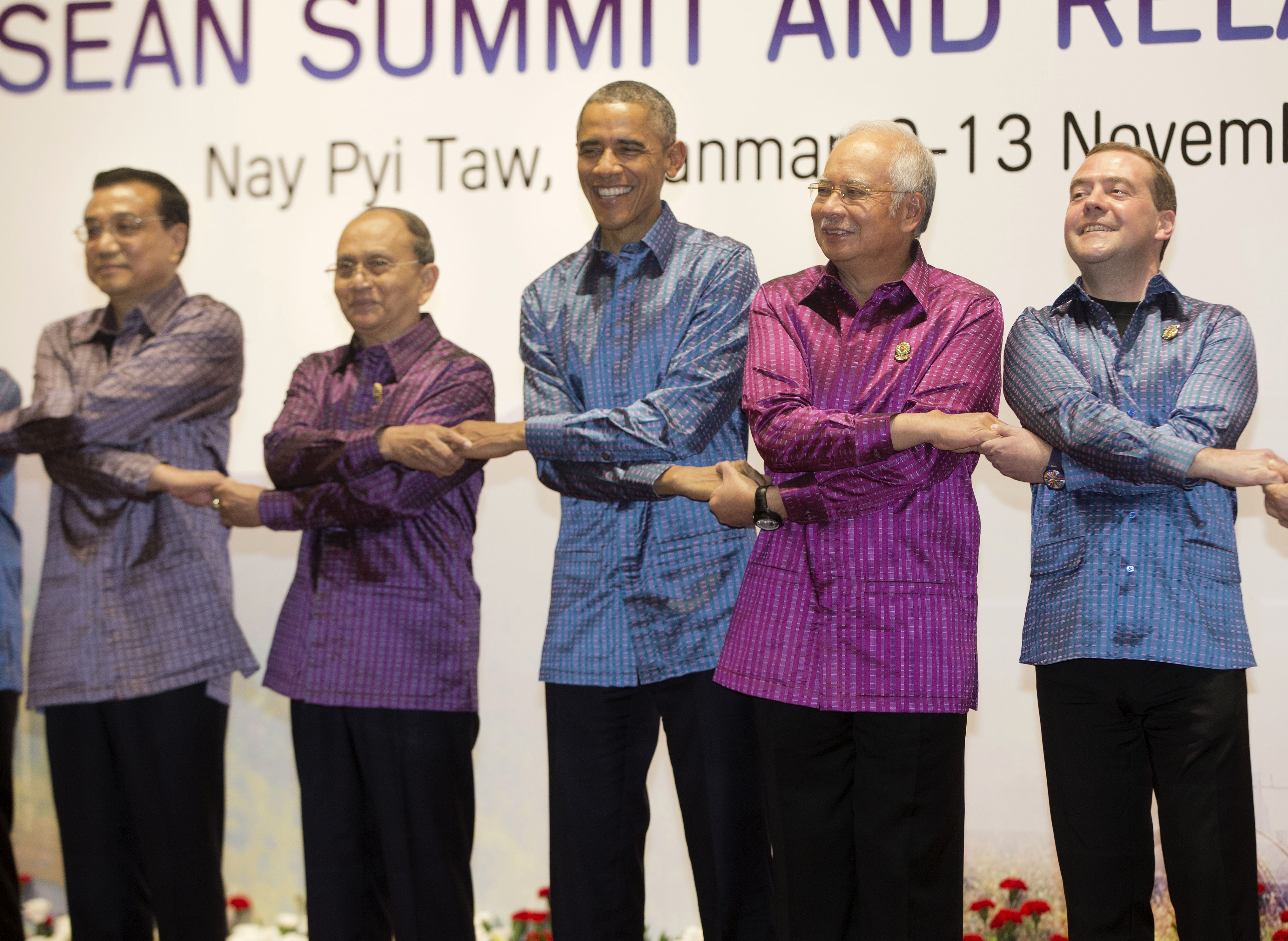 President Barack Obama and Myanmar President Thein Sein, second from left, pose during the East Asia Summit family photo at the Myanmar International Convention Center, Nov. 12, 2014, in Naypyitaw, Myanmar.