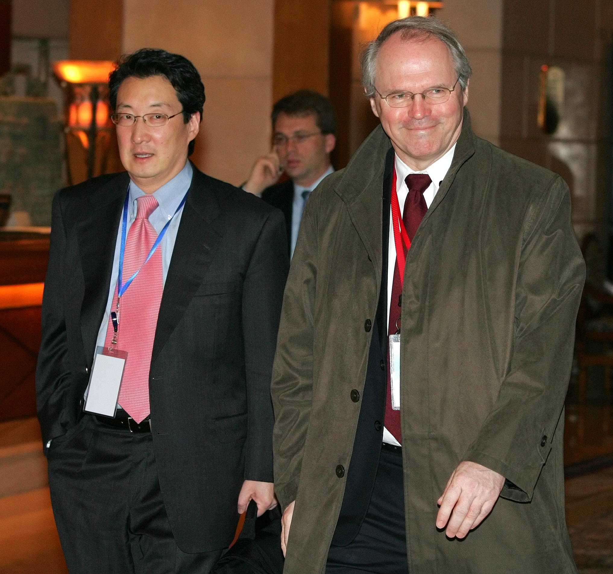 FILE - U.S. Assistant Secretary of State Christopher Hill, right, walks with Victor Cha, the U.S. National Security Council's director for Asian Affairs, before heading to six-party talks on North Korea's nuclear program, in Beijing, March 22, 2007.