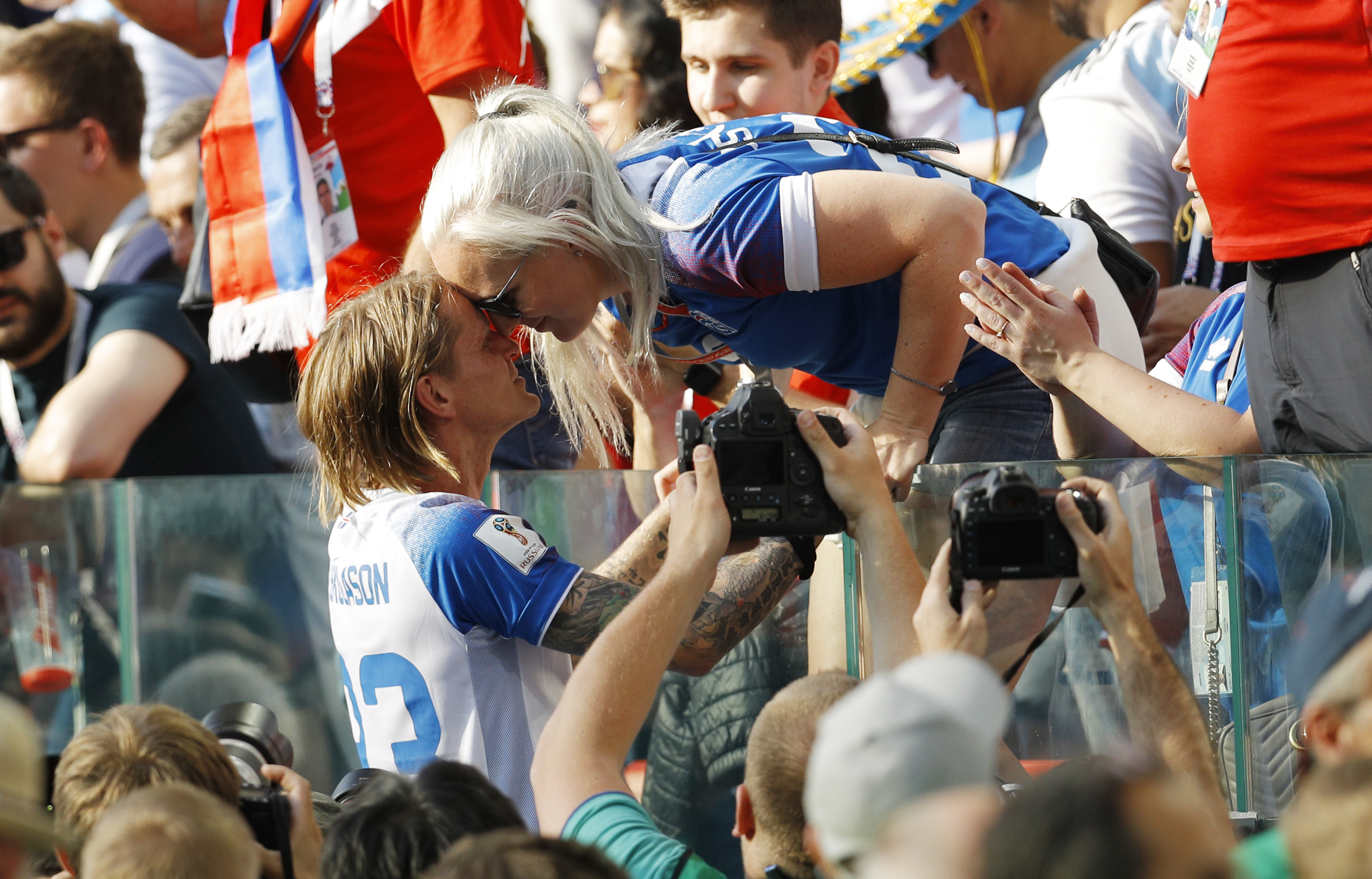 Iceland's Ari Skulason celebrates with a woman after a draw 1-1 in the group D match between Argentina and Iceland at the 2018 soccer World Cup in the Spartak Stadium in Moscow, Russia, June 16, 2018.