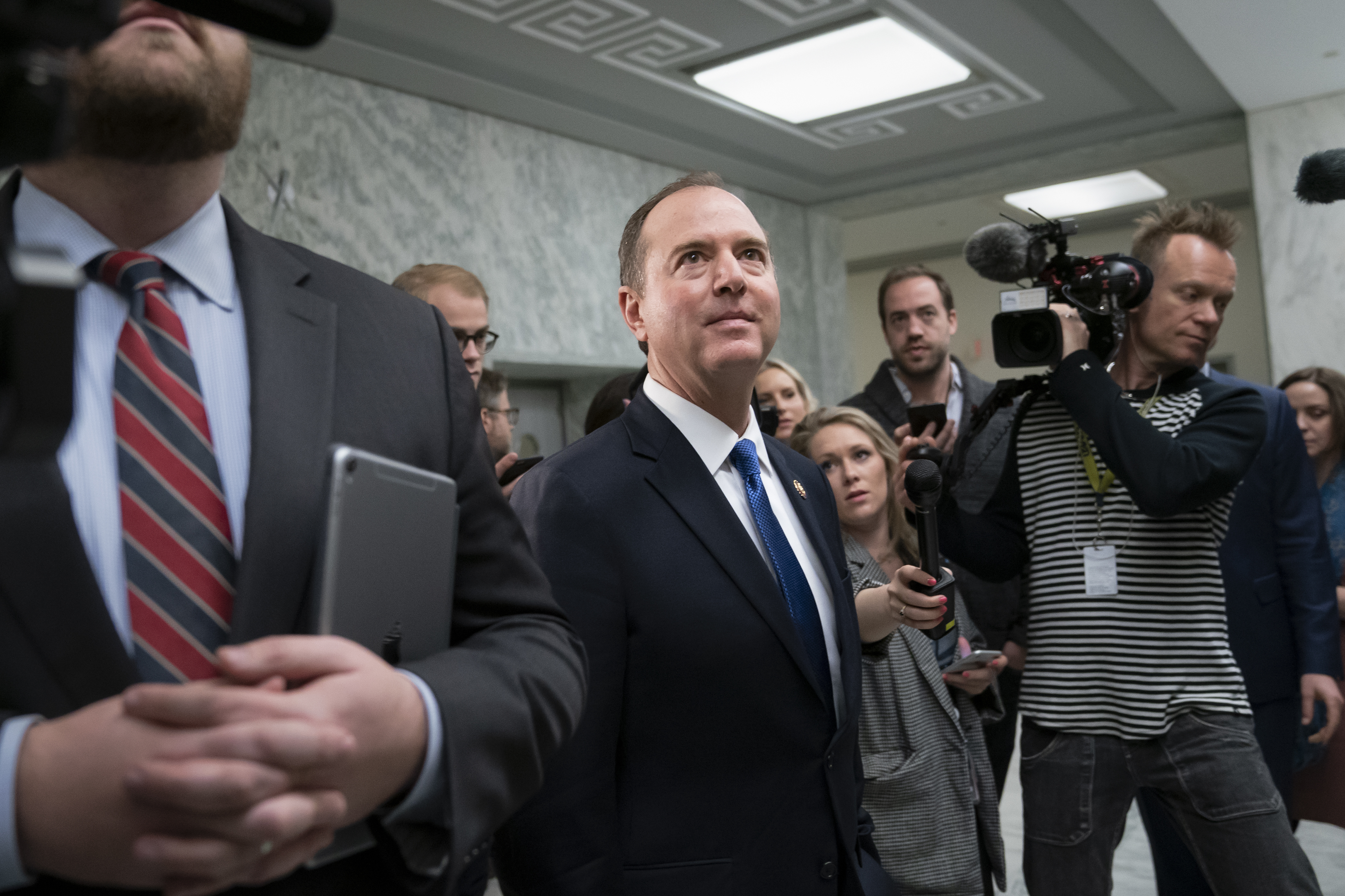 FILE - House Intelligence Committee Chairman Adam Schiff, D-Calif., evades reporters as he rushes to a vote during a committee hearing on Russia, on Capitol Hill in Washington, March 28, 2019.