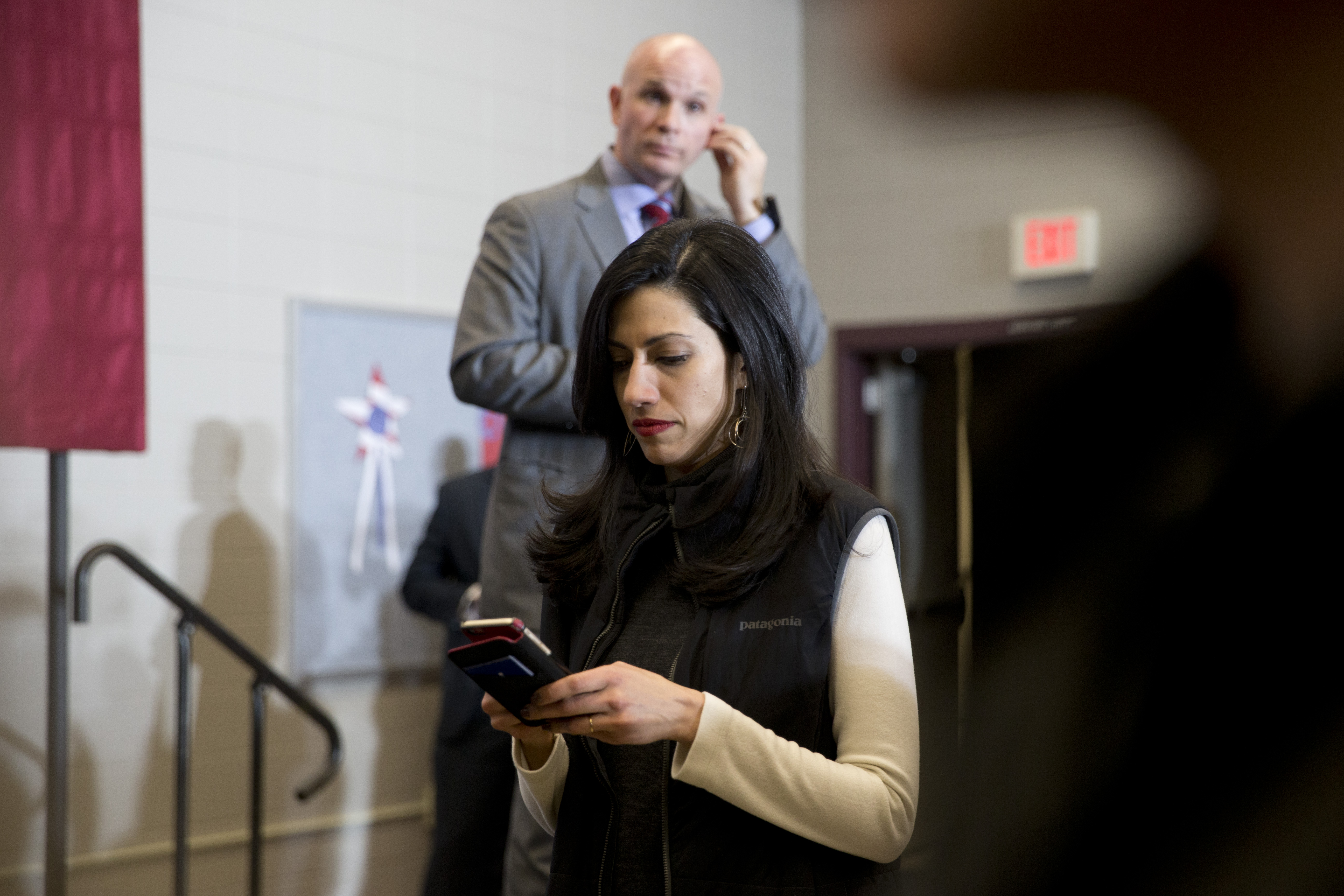 FILE - Huma Abedin, center, aide to Democratic presidential candidate Hillary Clinton is photographed during a campaign event at the Keokuk Middle School. A conservative group called Judicial Watch said in court filings it wants to question top Clint...