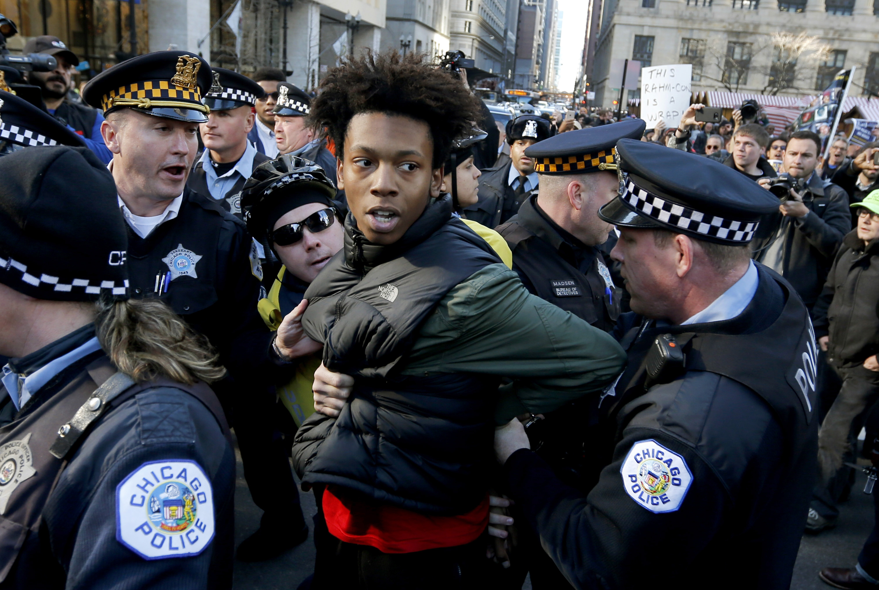 Lamon Reccord is taken into custody by Chicago police officers during a march calling for Chicago Mayor Rahm Emanuel and Cook County State's Attorney Anita Alvarez to resign, Dec. 9, 2015.