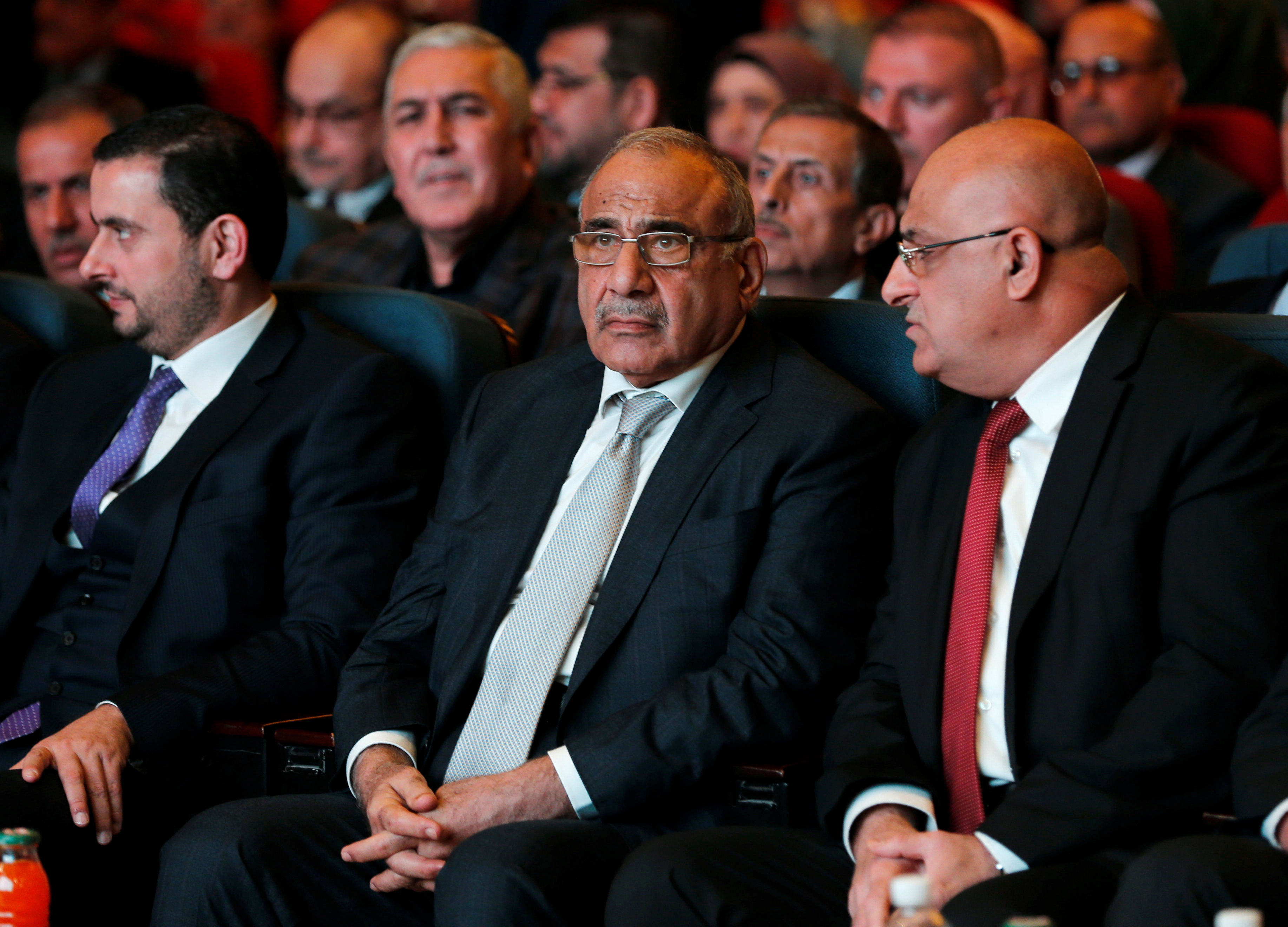 Iraq's Prime Minister Adel Abdul Mahd, center, attends the opening of  Baghdad International Fair, Iraq, Nov. 10, 2018.