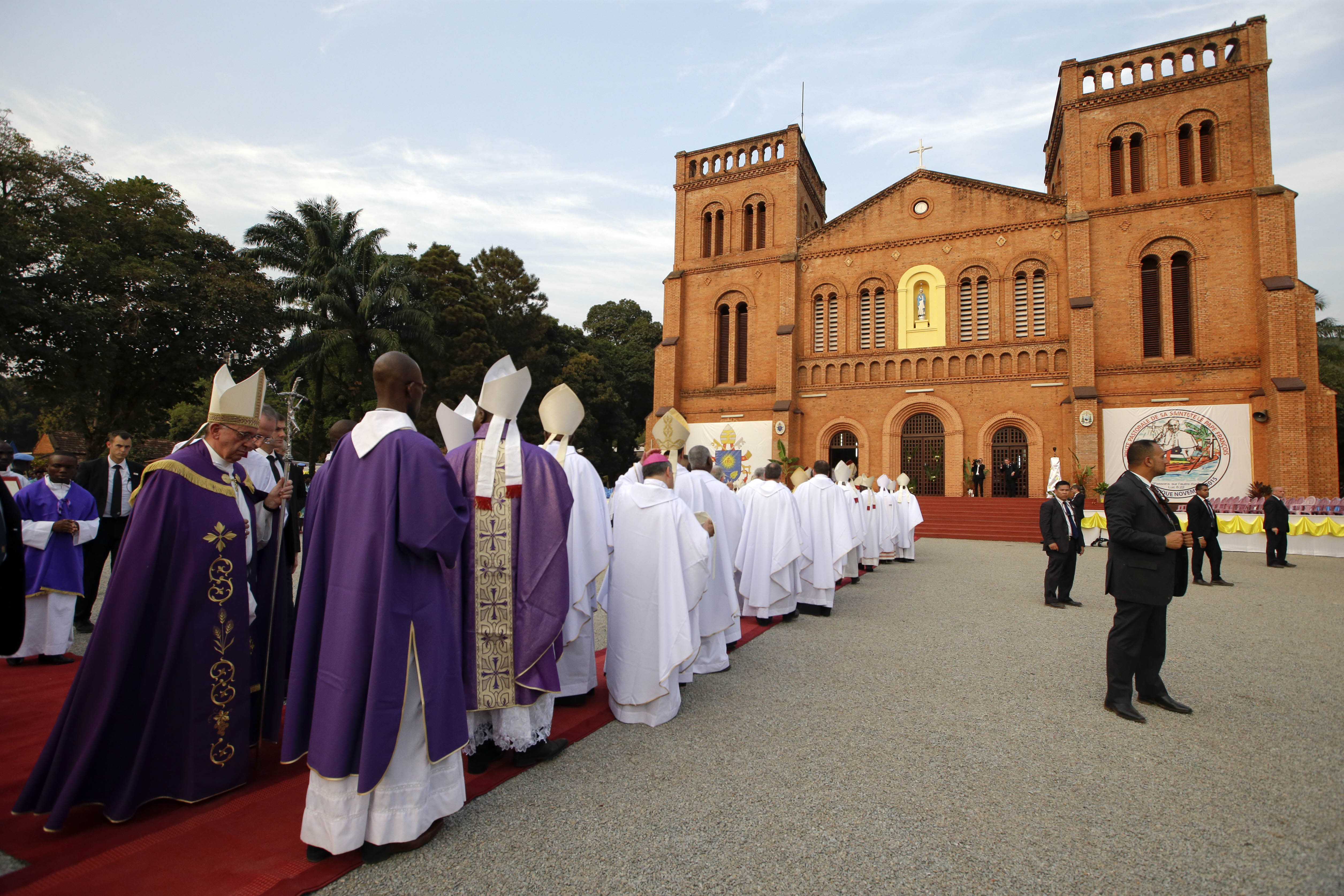 Pope Francis arrives to open the holy door of the Bangui cathedral, Central African Republic, Sunday, Nov. 29, 2015.