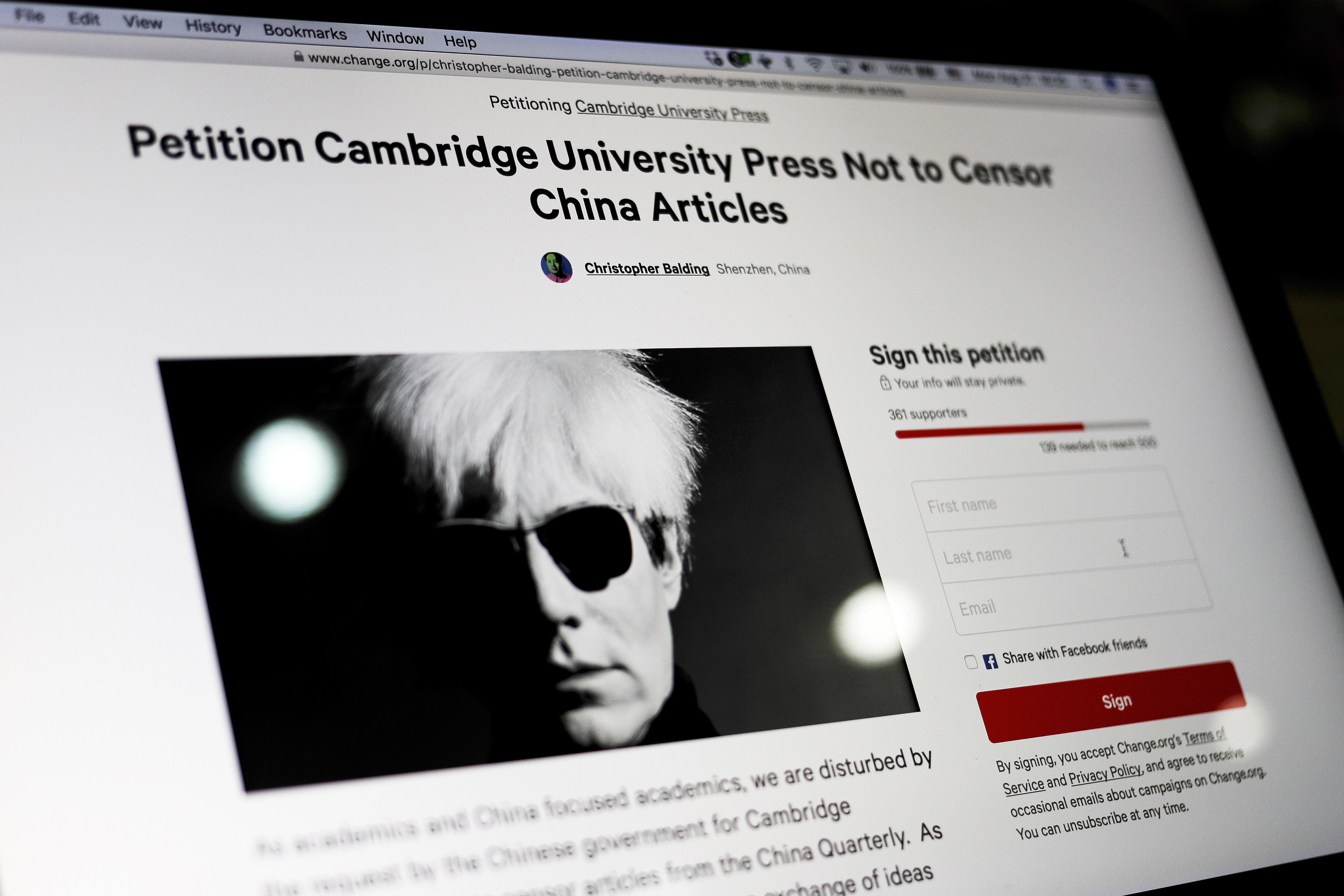A computer screen shows an online petition page urging Cambridge University Press to restore more than 300 politically sensitive articles removed from its website in China after a request from authorities, in Beijing, Aug. 21, 2017.