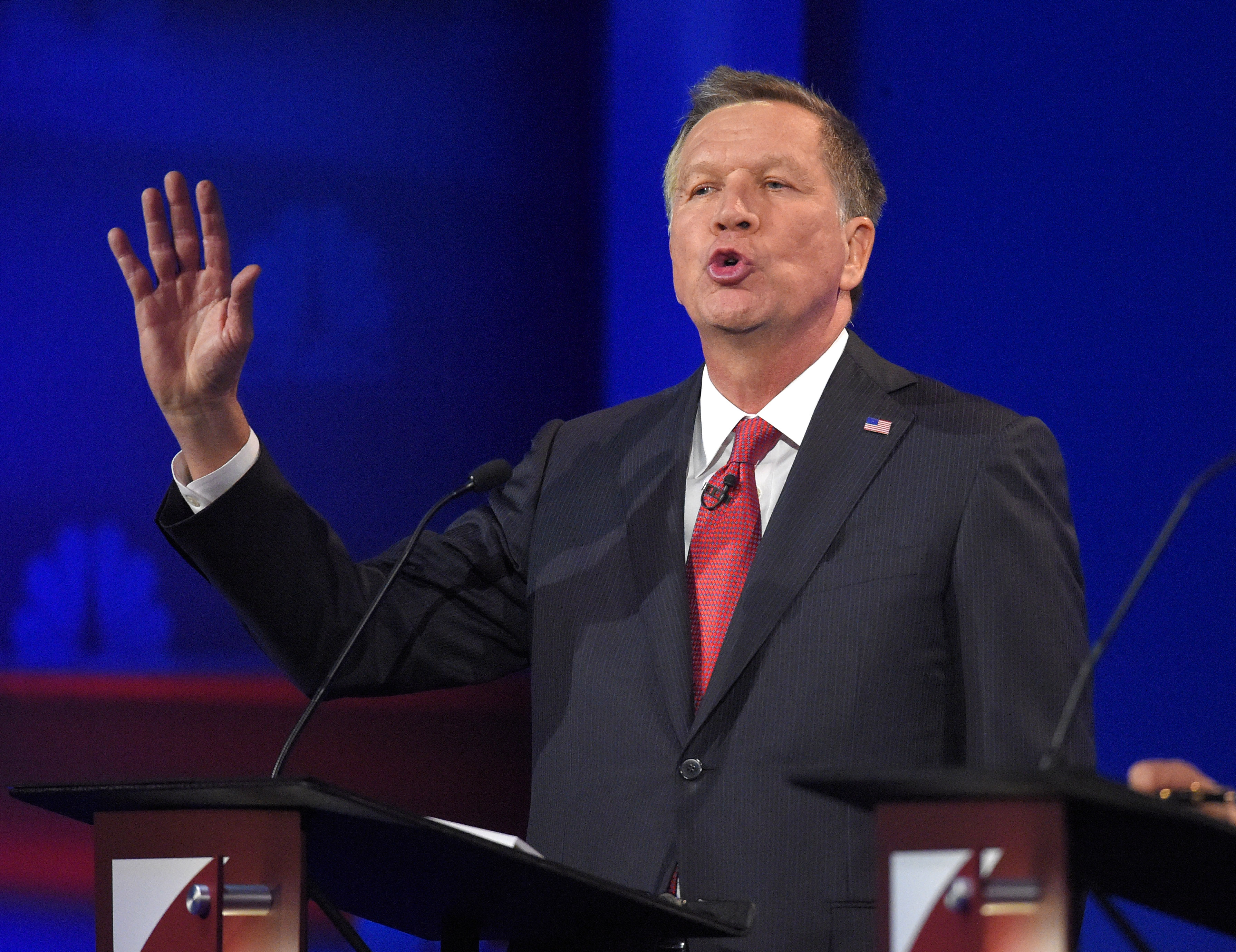 John Kasich makes a point during the CNBC Republican presidential debate at the University of Colorado, Wednesday, Oct. 28, 2015.