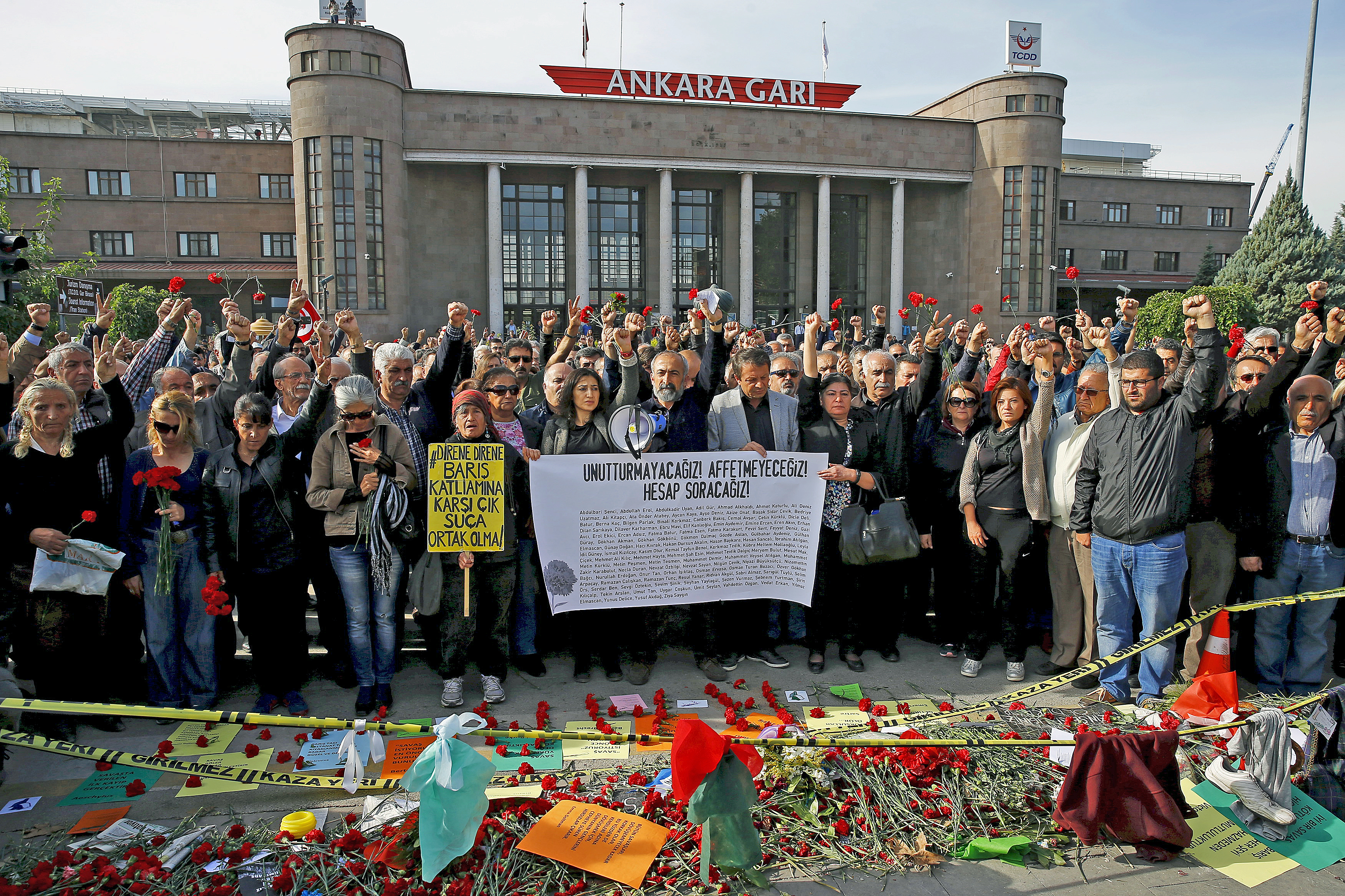People attend a commemoration for the victims of the October 10 bombings in Ankara, Turkey, Oct. 17, 2015.