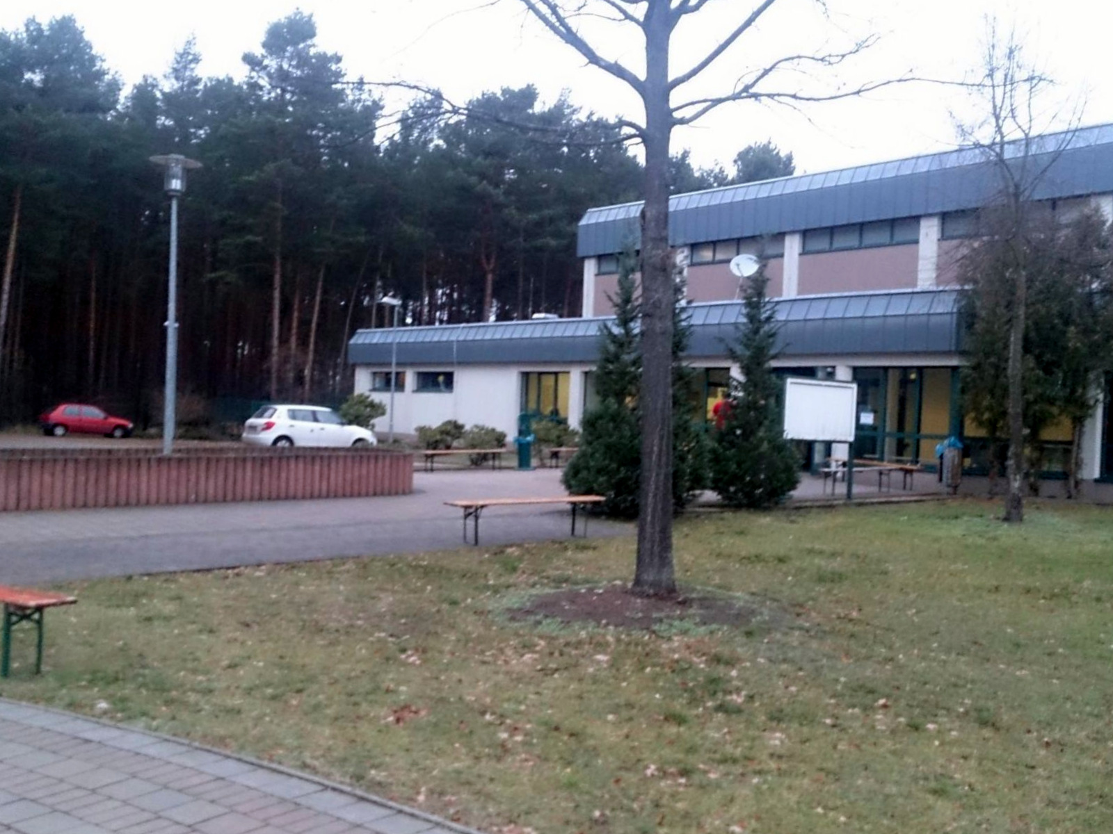Set in the forest adjacent to a military base, refugees in this camp in Holzdorf, Germany, say they are so isolated that they really don't know if increased European terrorist alerts has sparked xenophobia, Nov. 28, 2015. (VOA News)