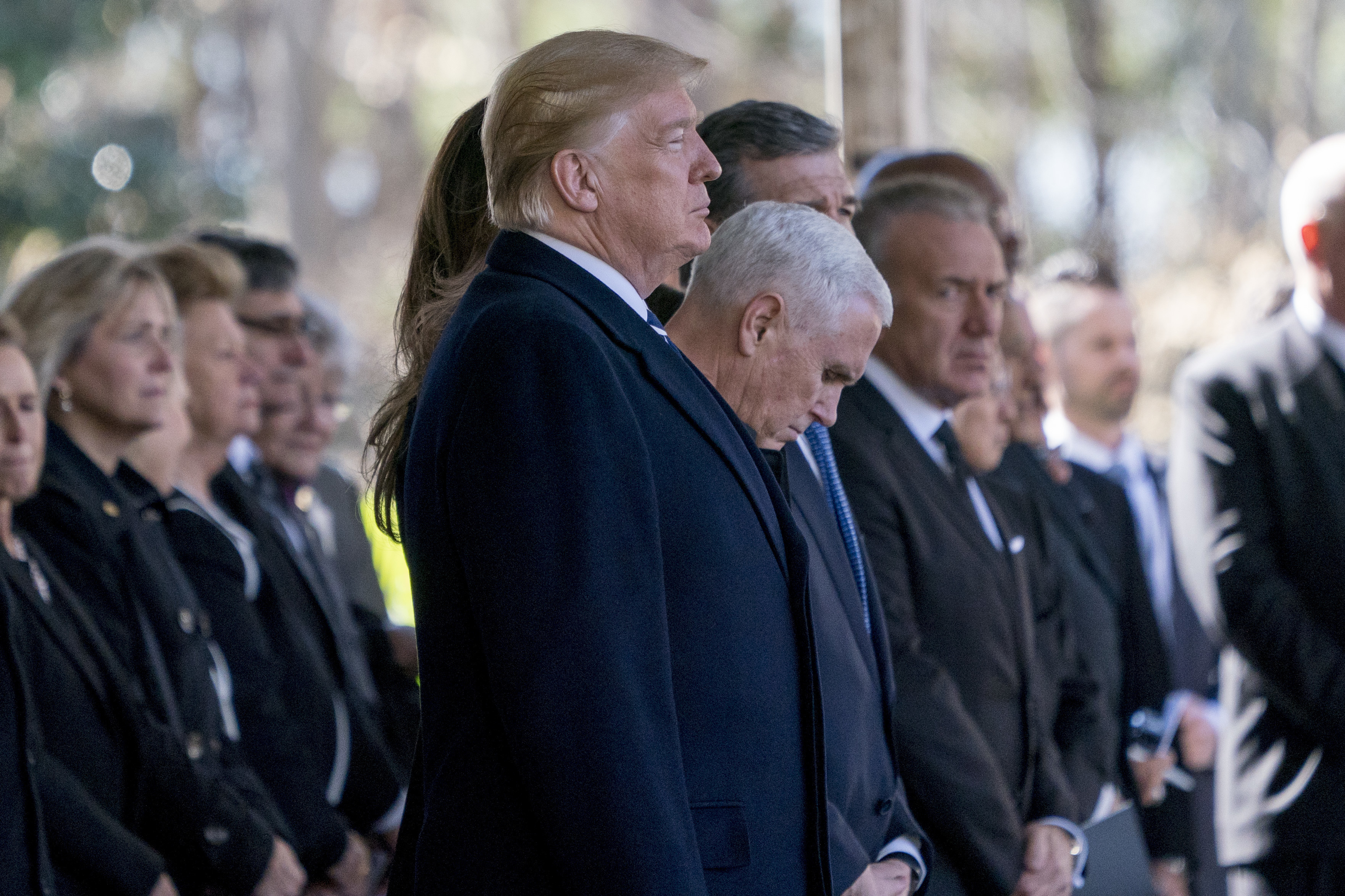 President Donald Trump and Vice President Mike Pence, center right, arrive at the funeral of Reverend Billy Graham in Charlotte, N.C., March 2, 2018.