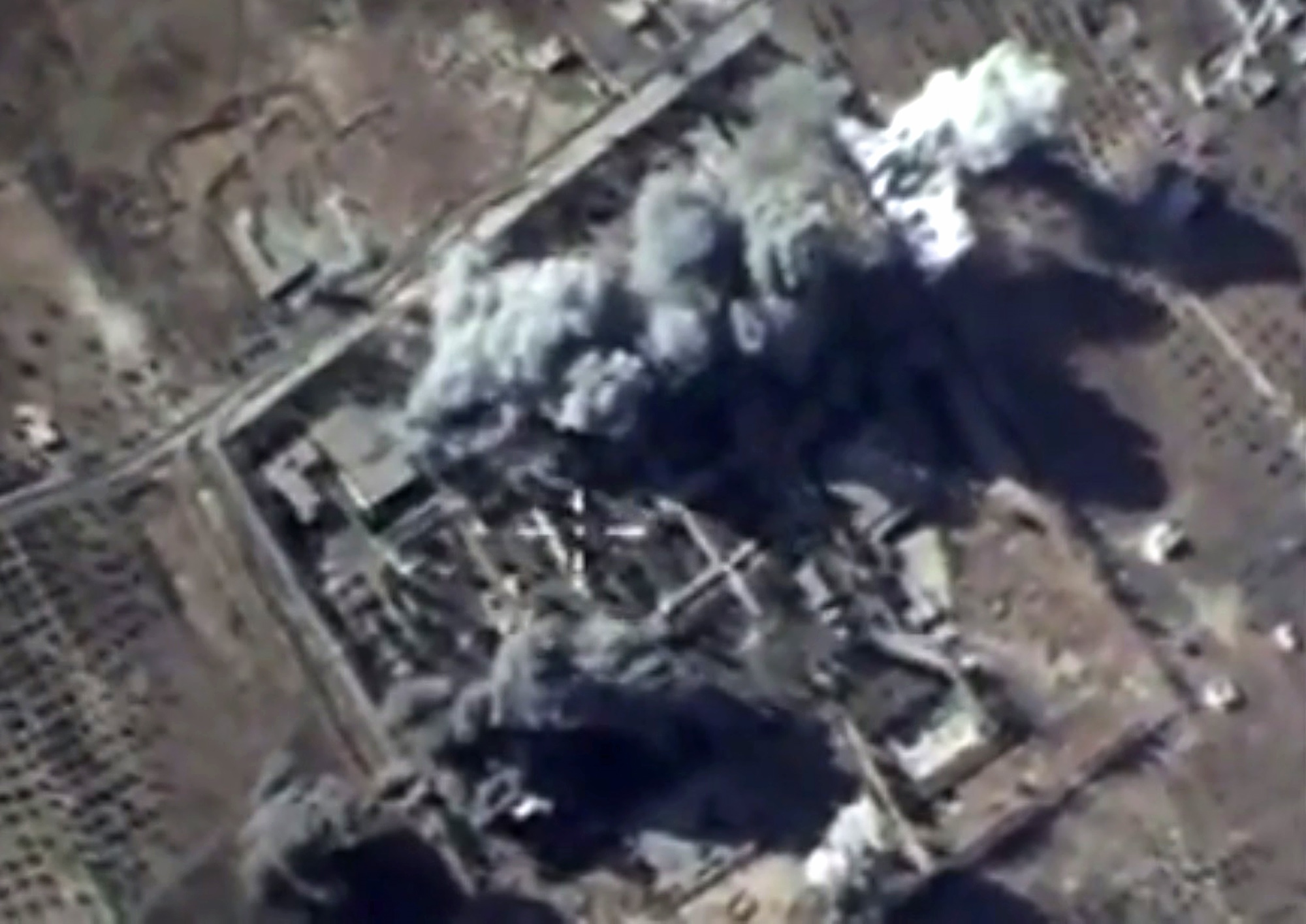 A video grab made on October 12, 2015, shows an image taken from a footage made available on the Russian Defence Ministry's official website, purporting to show explosions after airstrikes carried out by Russian air force on what Russia says was an I...