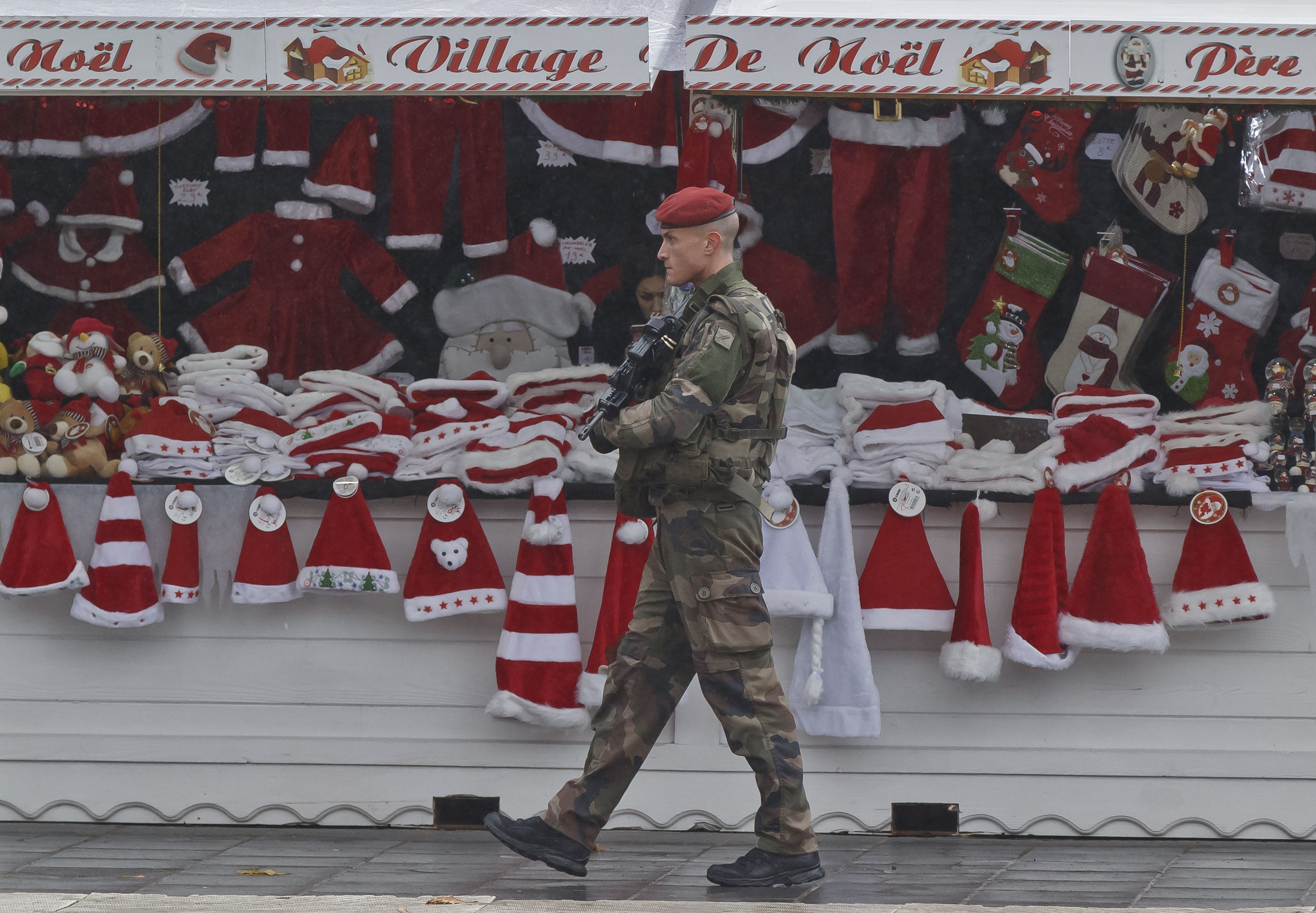A soldiers patrols at the Christmas market along the Champs Elysees avenue in Paris, Nov. 24, 2015.