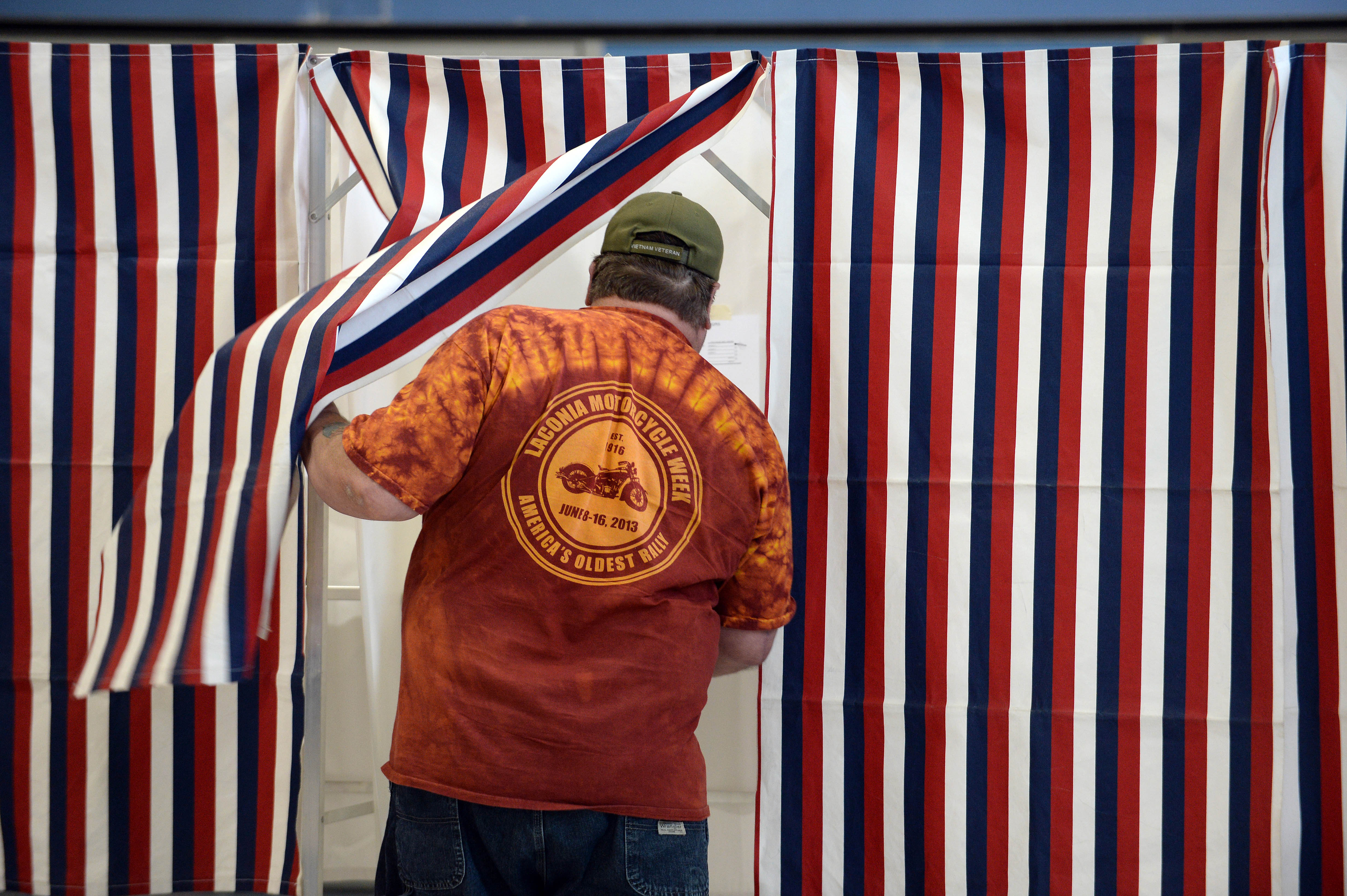 A voter enters the voting booth at Bishop Leo E. O'Neil Youth Center in Manchester, New Hampshire, Nov. 4, 2014.