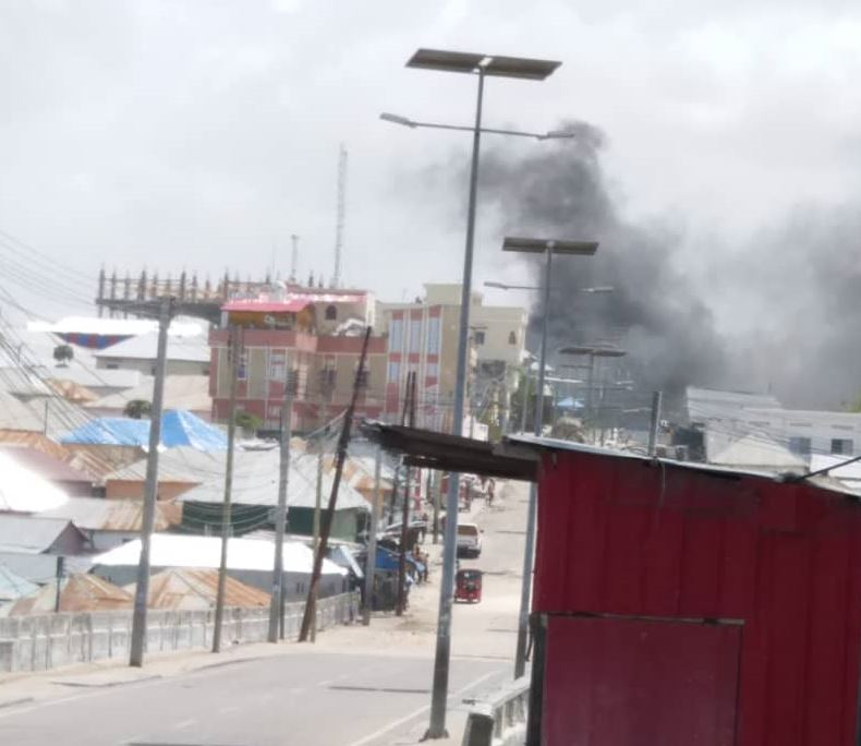 Smoke is seen rising above the scene of the compound of Somalia's interior and security ministries, following a deadly attack by al-Shabab, July 7, 2018. (VOA/A. Abdulle)