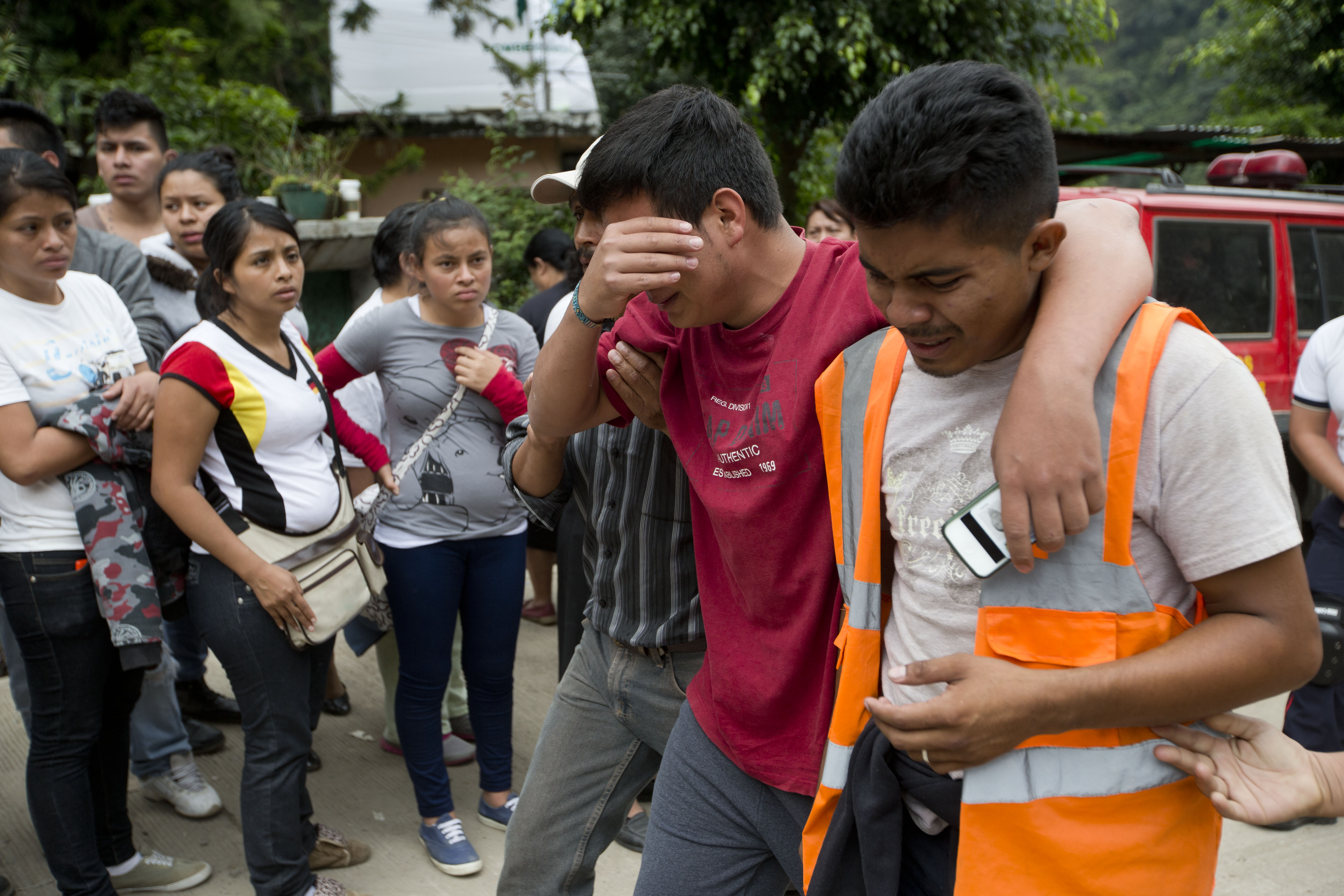 Residents cry after finding out one of their family members died in the mudslide in Cambray, a neighborhood in the suburb of Santa Catarina Pinula, on the outskirts of Guatemala City, Oct. 3, 2015.