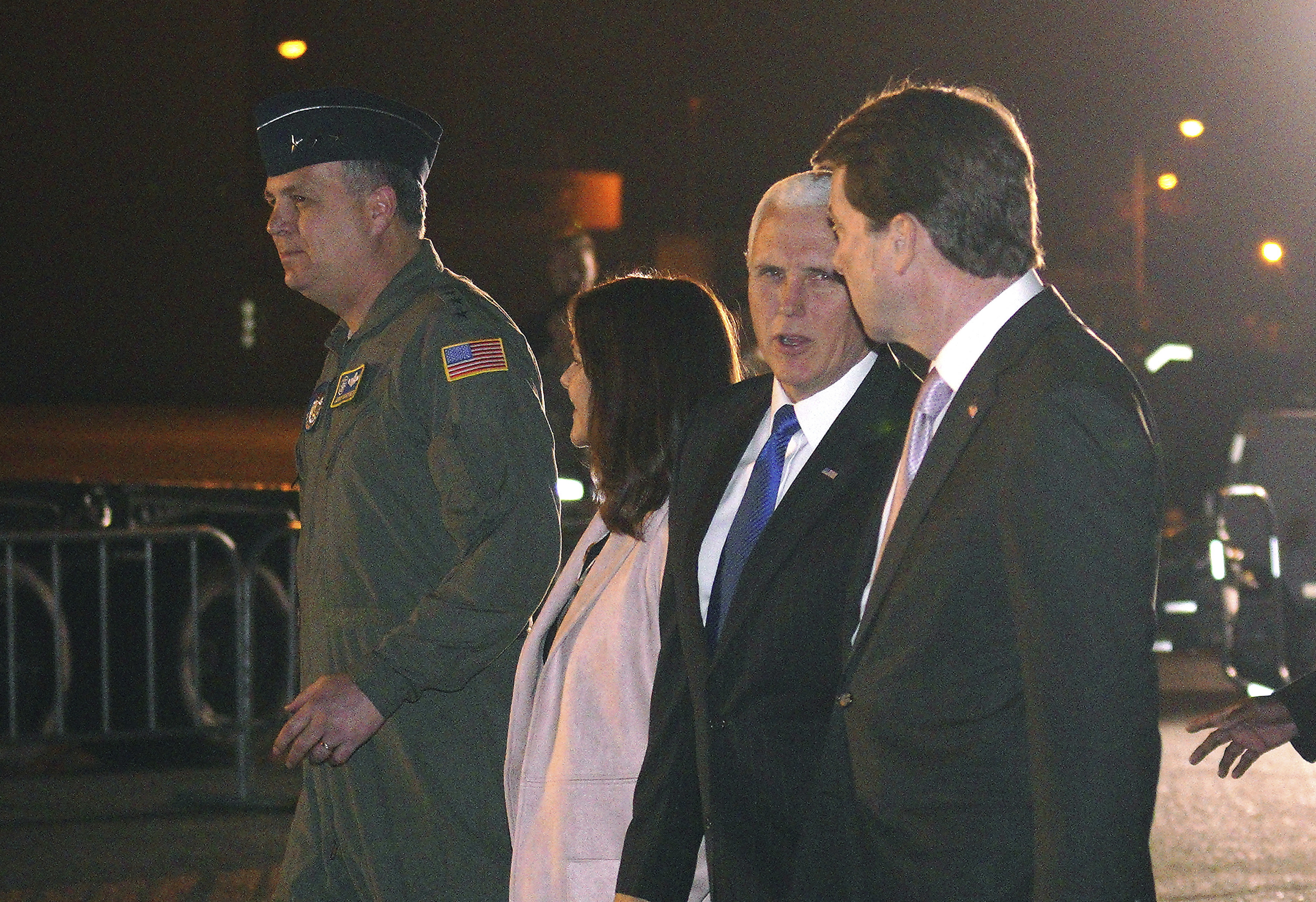 U.S. Vice President Mike Pence, second right, and his wife Karen are escorted to a waiting helicopter by the U.S. Ambassador to Japan William Hagerty, right in Fussa, Japan, Nov. 12, 2018.