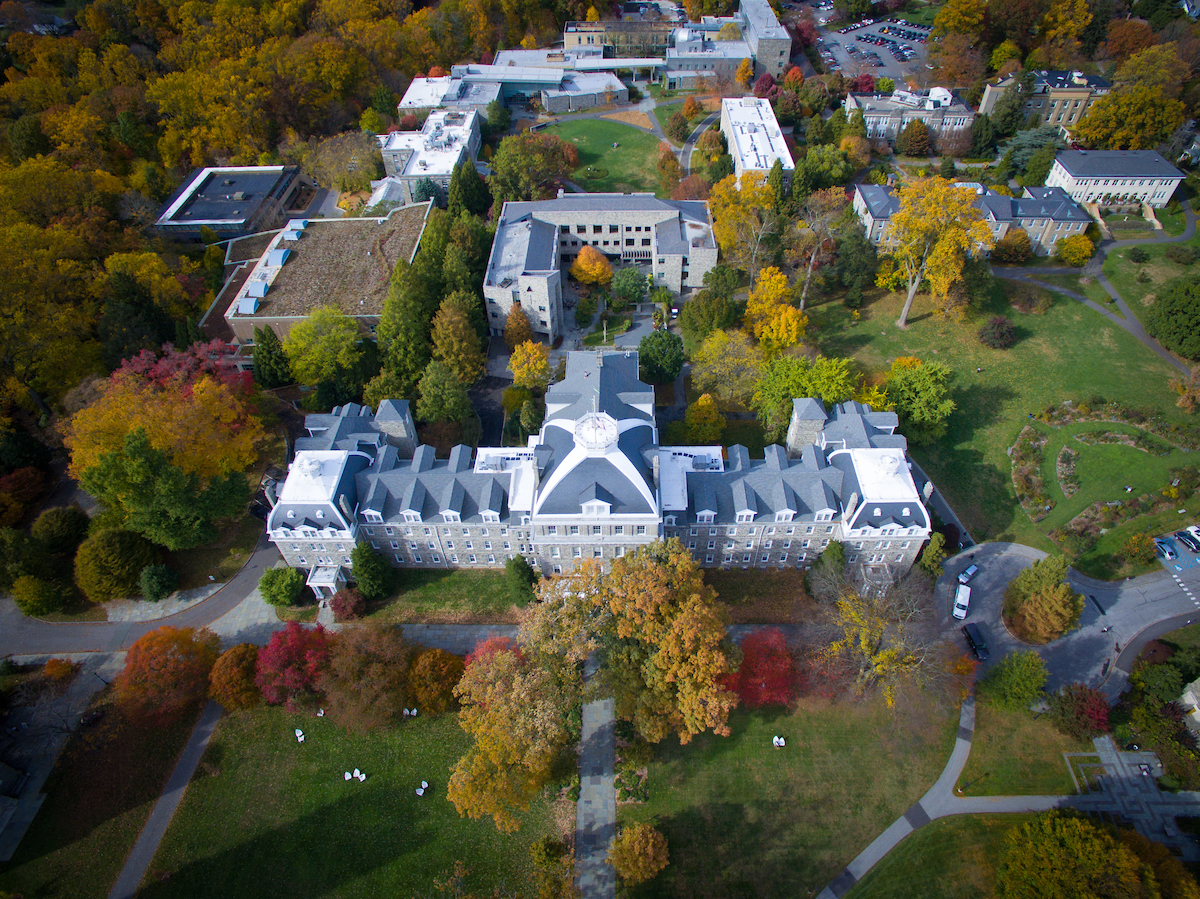 Aerial drone photography of the Swarthmore campus displaying the fall foliage and skyline