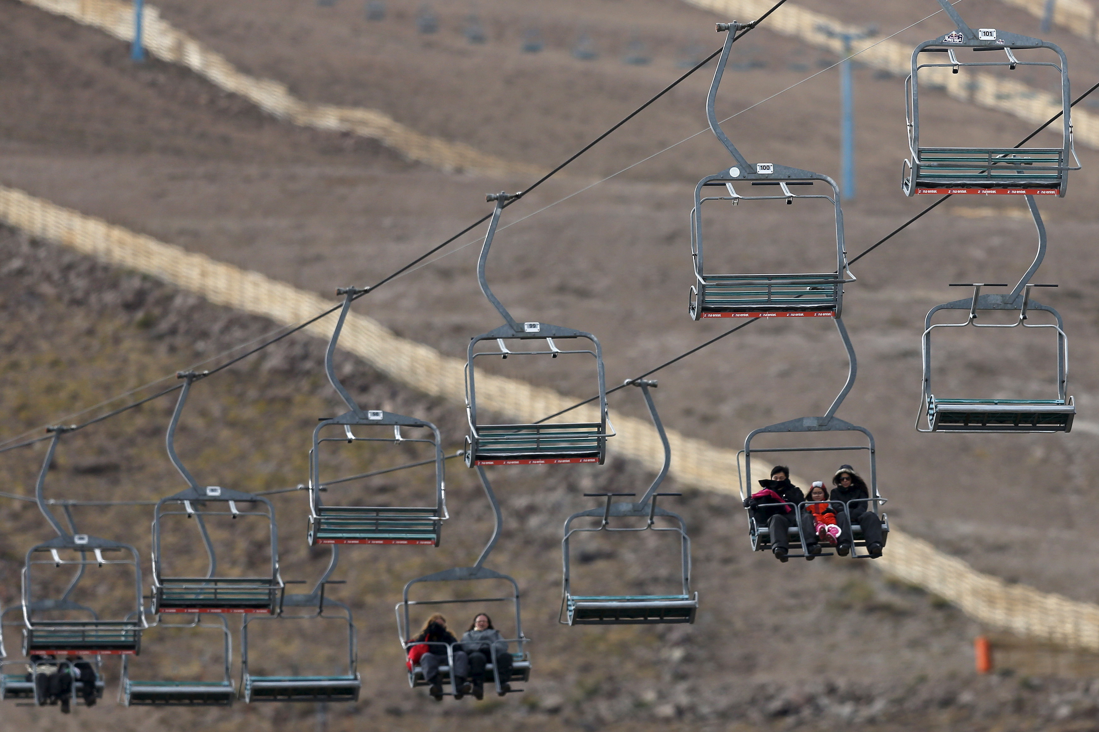 Tourists ride the chairlift at the El Colorado ski centre at Los Andes Mountain range, near Santiago, Chile, July 1, 2015.