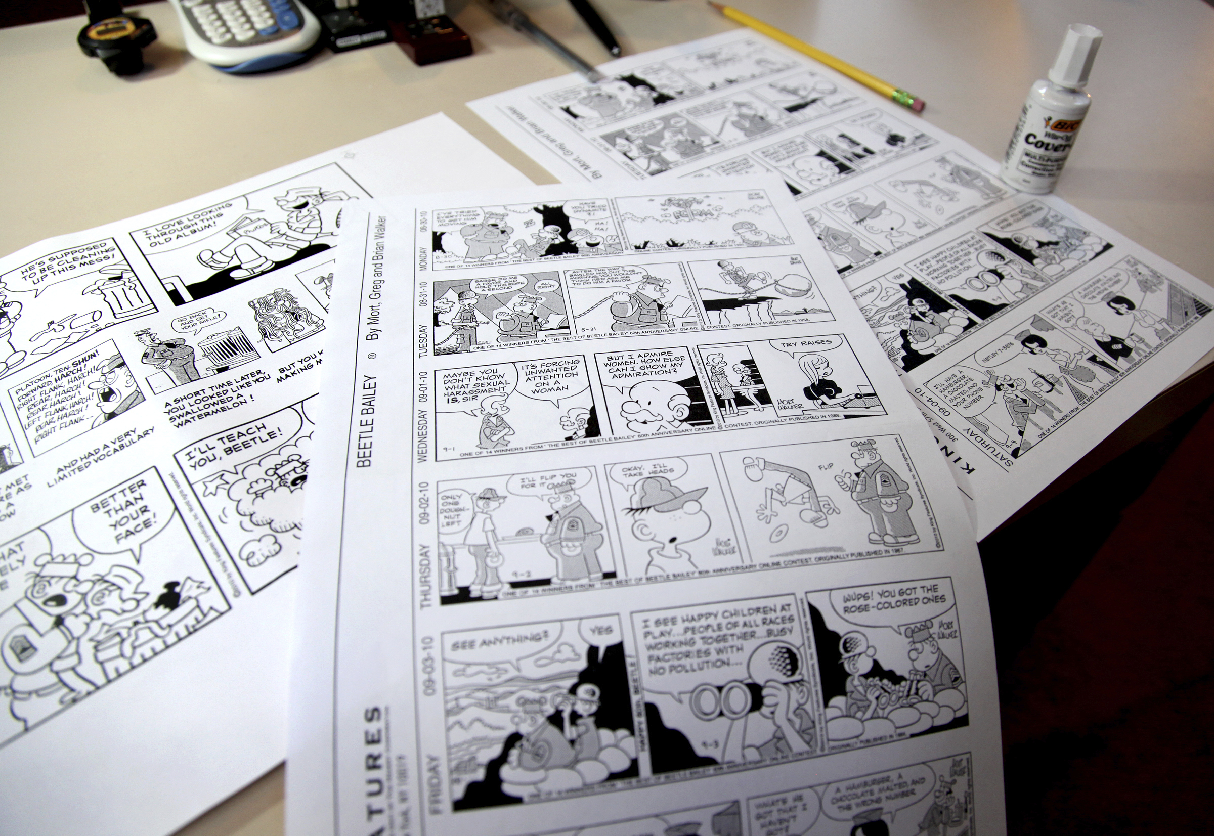 """FILE - """"Beetle Bailey"""" comic strips to be published in the coming weeks rest on a desk in the studio of creator Mort Walker in Stamford, Conn., Aug. 16, 2010. On Jan. 27, 2018, a family member said the comic strip artist had died. He was 94."""