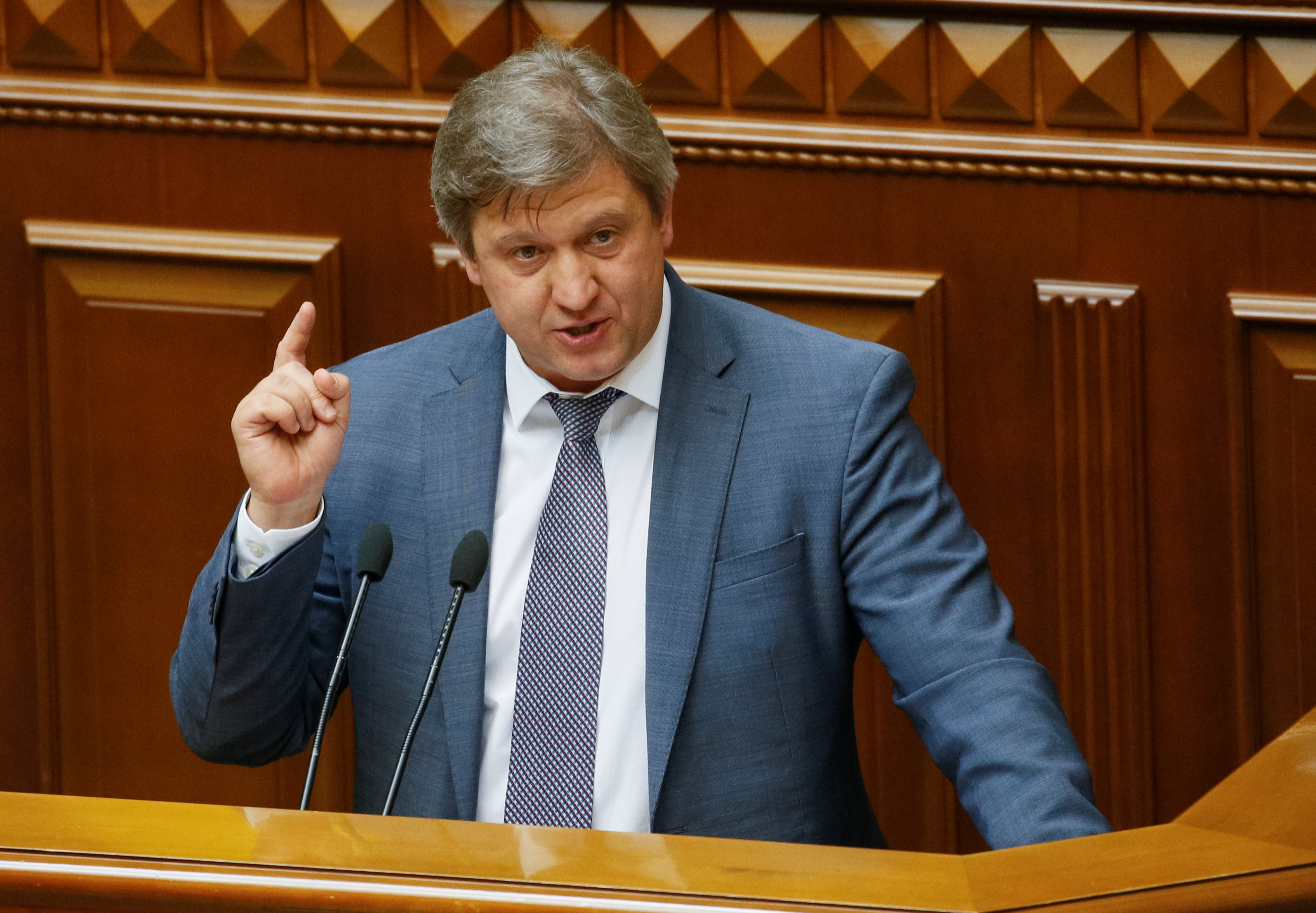 Ukrainian finance minister Oleksandr Danylyuk addresses lawmakers before voting on his dismissal during a parliament session in Kyiv, Ukraine June 7, 2018.