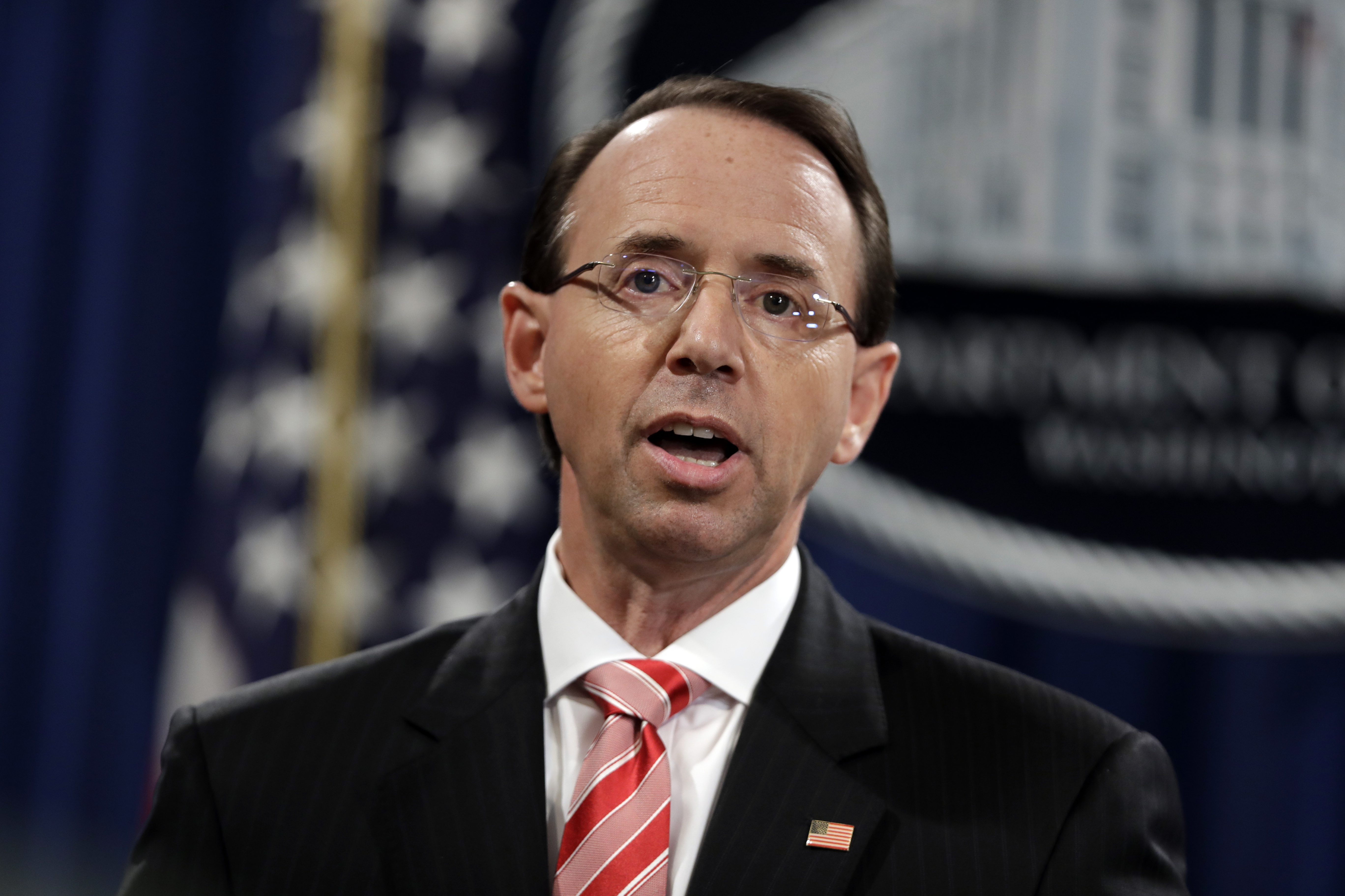 FILE - Deputy Attorney General Rod Rosenstein speaks during a news conference at the Department of Justice, July 13 2018. Rosenstein is defending the prosecution of foreign agents who may never see the inside of a U.S. courtroom.