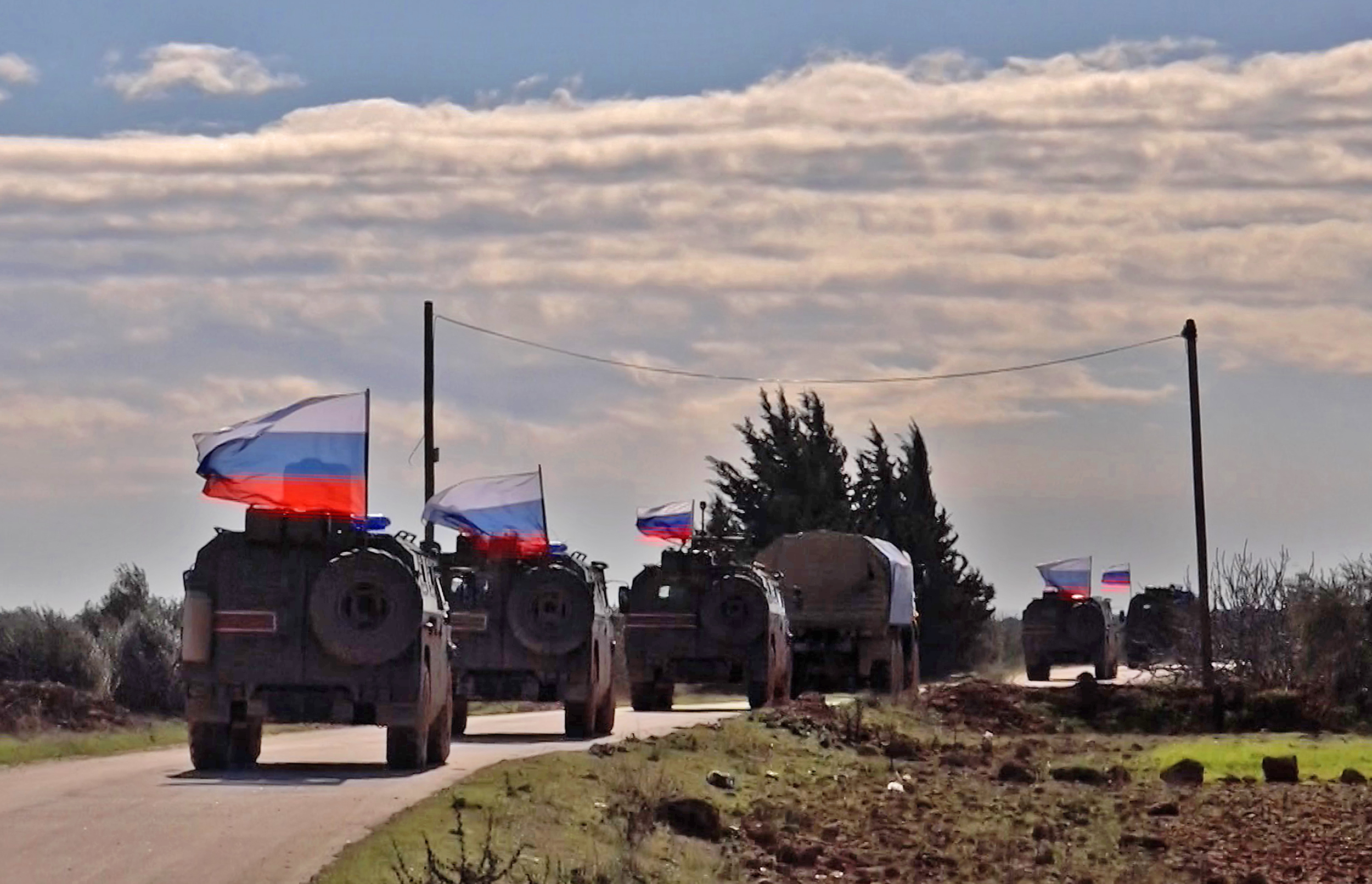 An image grab taken from AFP TV, Jan. 17, 2019, shows Russian army vehicles on patrol in the area of Arimah, just west of Manbij, the northern city near the Turkish border where a day earlier a suicide attack on a restaurant killed four Americans.