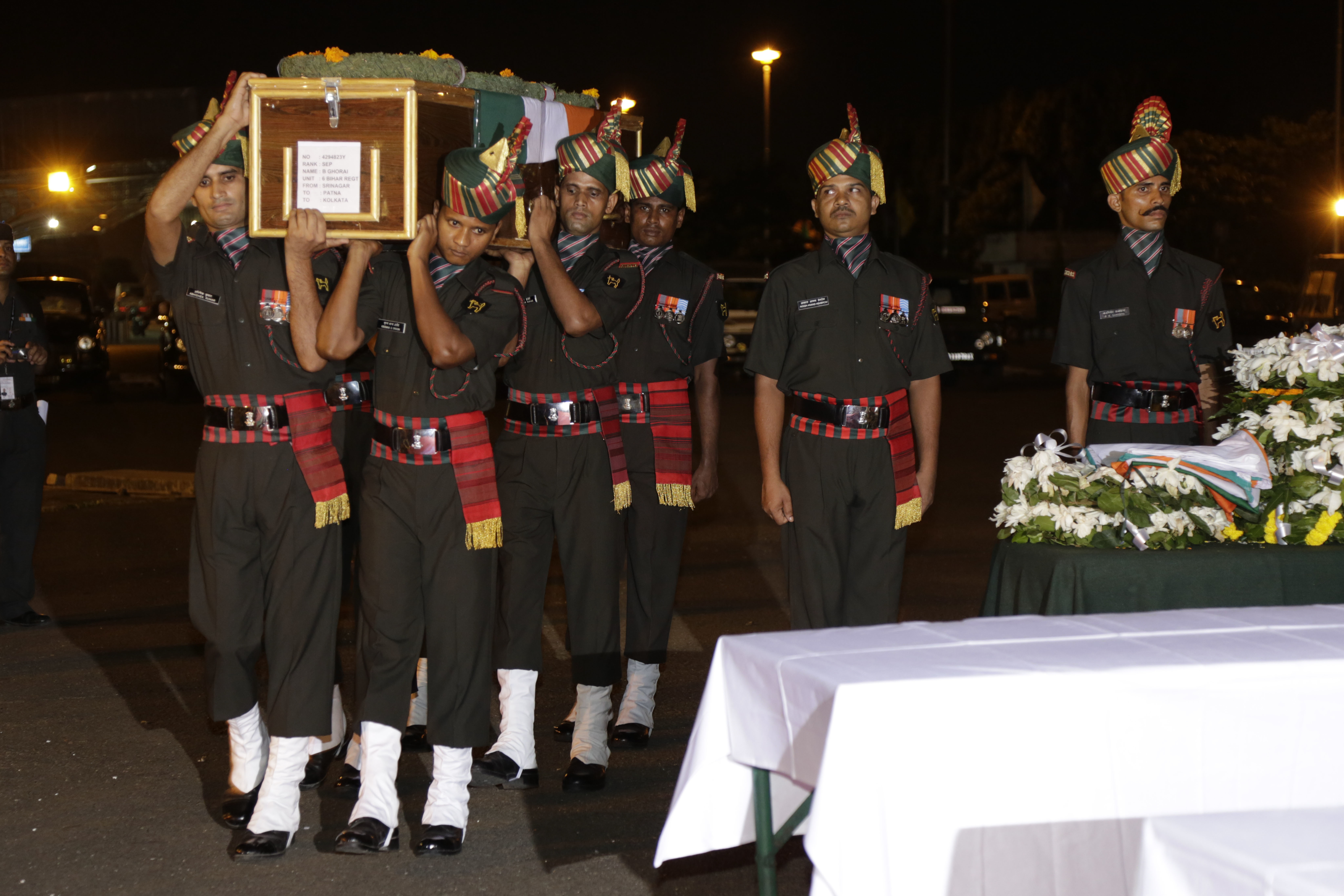Coffins containing bodies of Indian soldiers G. Doloi and Biaswajit Garai, killed in Sunday's attack at the Indian army base in Kashmir, arrive at the Netaji Subhas Chandra Bose International airport in Kolkata, India, Sept. 19, 2016.