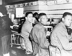 Four North Carolina A&T College students, including Ronald Martin (left) and Robert Patterson, were arrested for sitting at a Woolworth's lunch counter in Greensboro, North Carolina, in 1960.