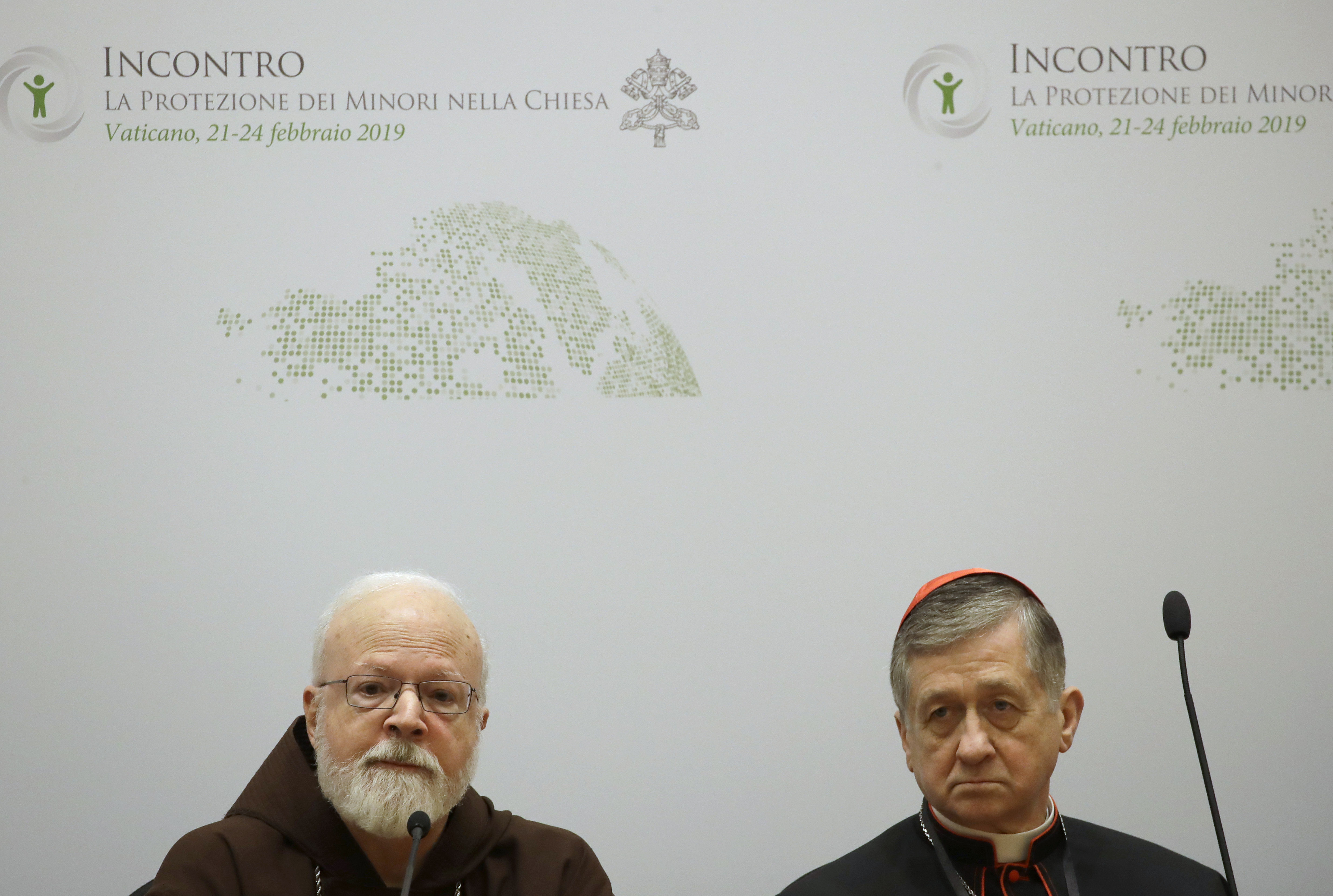 Cardinal Blase J. Cupich, Chicago Archbishop, right, and Cardinal Sean Patrick O'Malley, listen to reporters' questions during a four-day sex abuse summit called by Pope Francis, in Rome, Feb. 22, 2019.