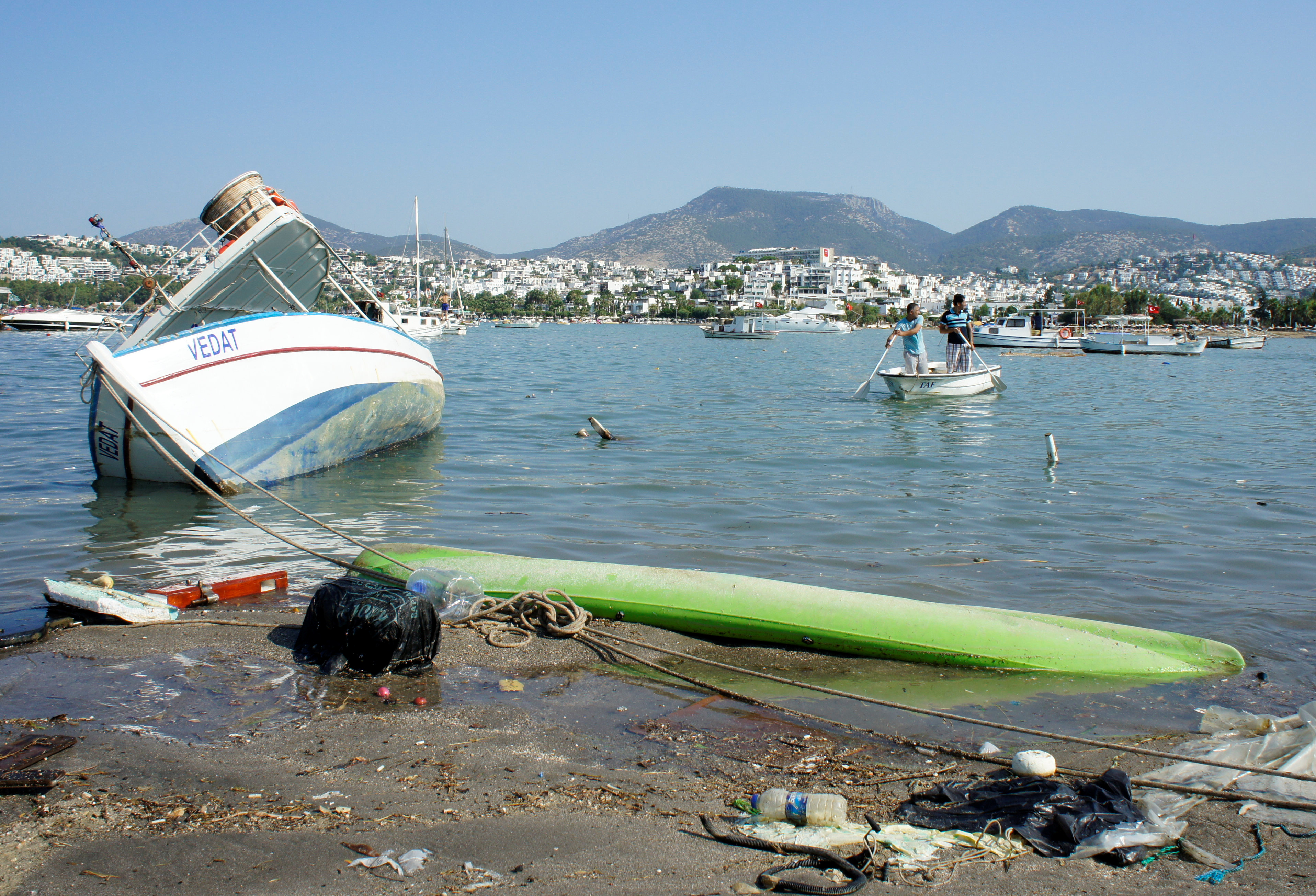 Damaged boats are seen after an earthquake and a tsunami in the resort town of Gumbet in Mugla province, Turkey, July 21, 2017.