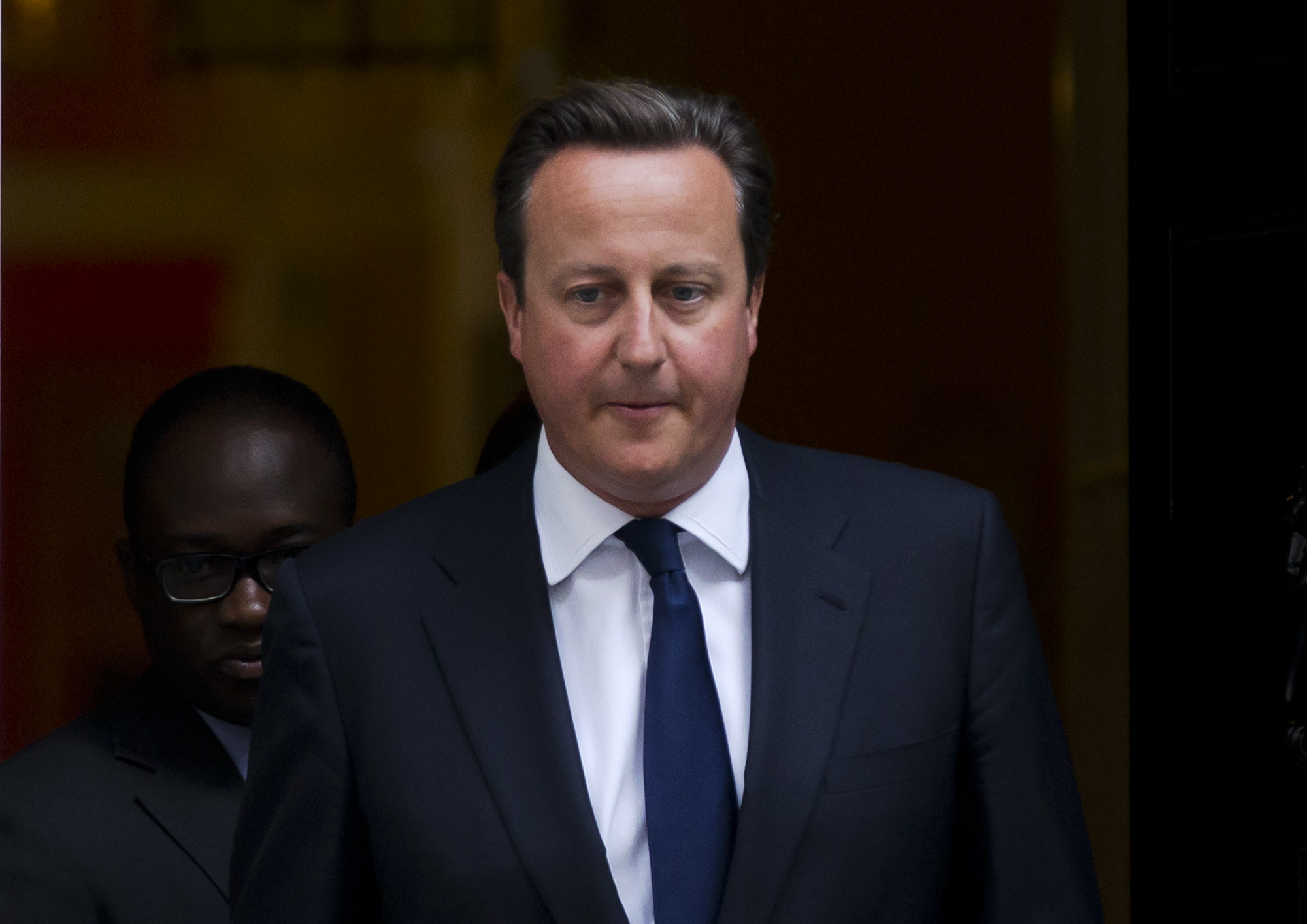 Britain's Prime Minister David Cameron leaves 10 Downing Street in London, to be driven to the Houses of Parliament for a debate and vote on Syria, Aug. 29, 2013.
