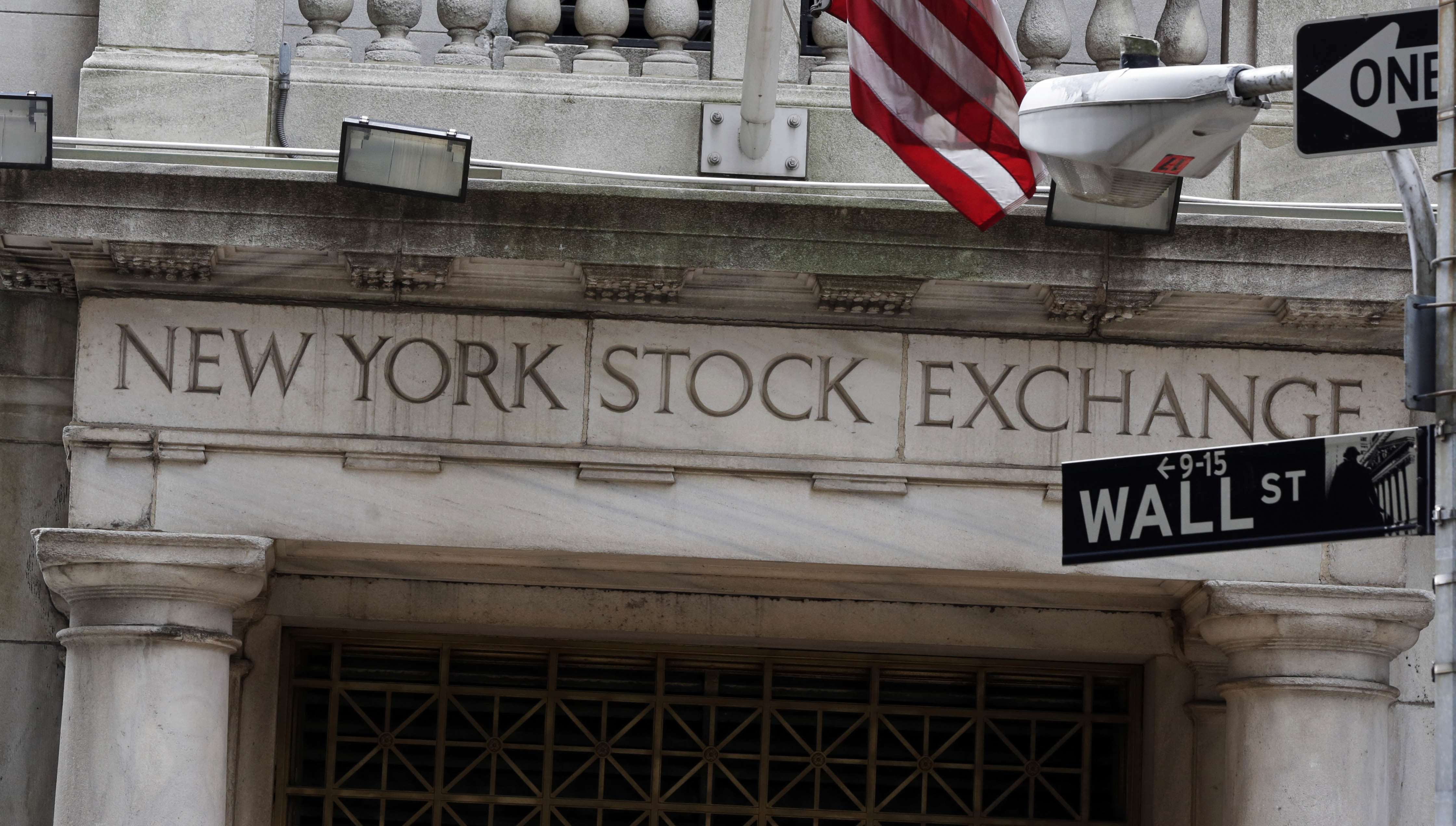 This Oct. 2, 2014 file photo shows the Wall Street entrance of the New York Stock Exchange.