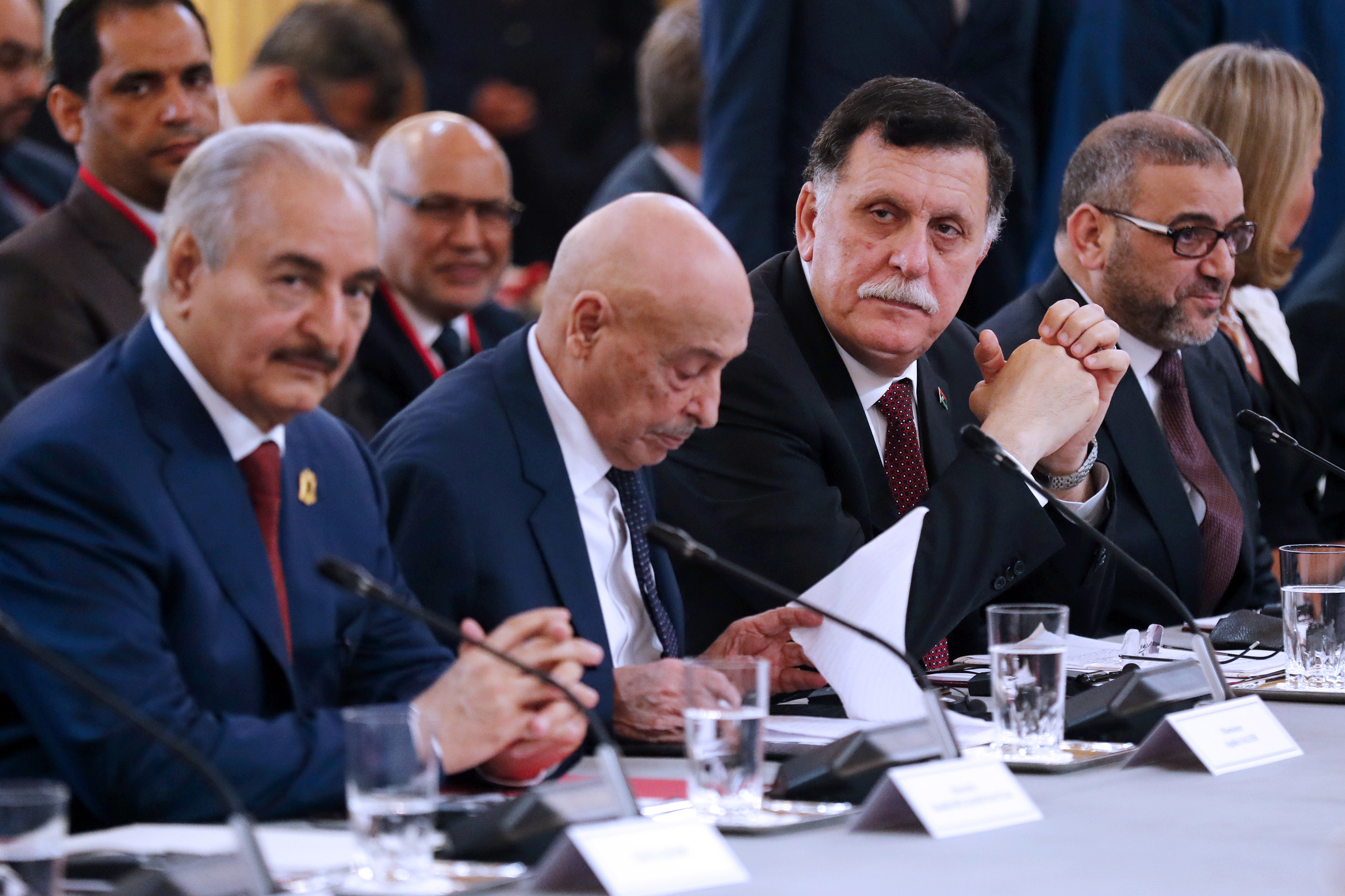 Libya Chief of Staff, Marshall Khalifa Haftar, President of the Libyan House of Representatives in Tobruk Aguila Saleh Issa, Chairman of the Presidential Council of Libya, Fayez al-Sarraj, and Khaled Mechri attend a conference on Libya, at the Elysee...