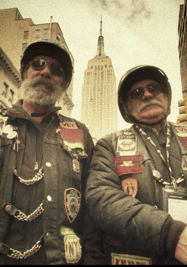 Vietnam-era veteran Frank Mulholland (right) and his buddy in the New York Chapter of 'Nam Knights, rode up Fifth Avenue in the Veteran's Day Parade to honor all veterans in America's many wars, Nov. 11, 2013. (VOA/A. Phillips)